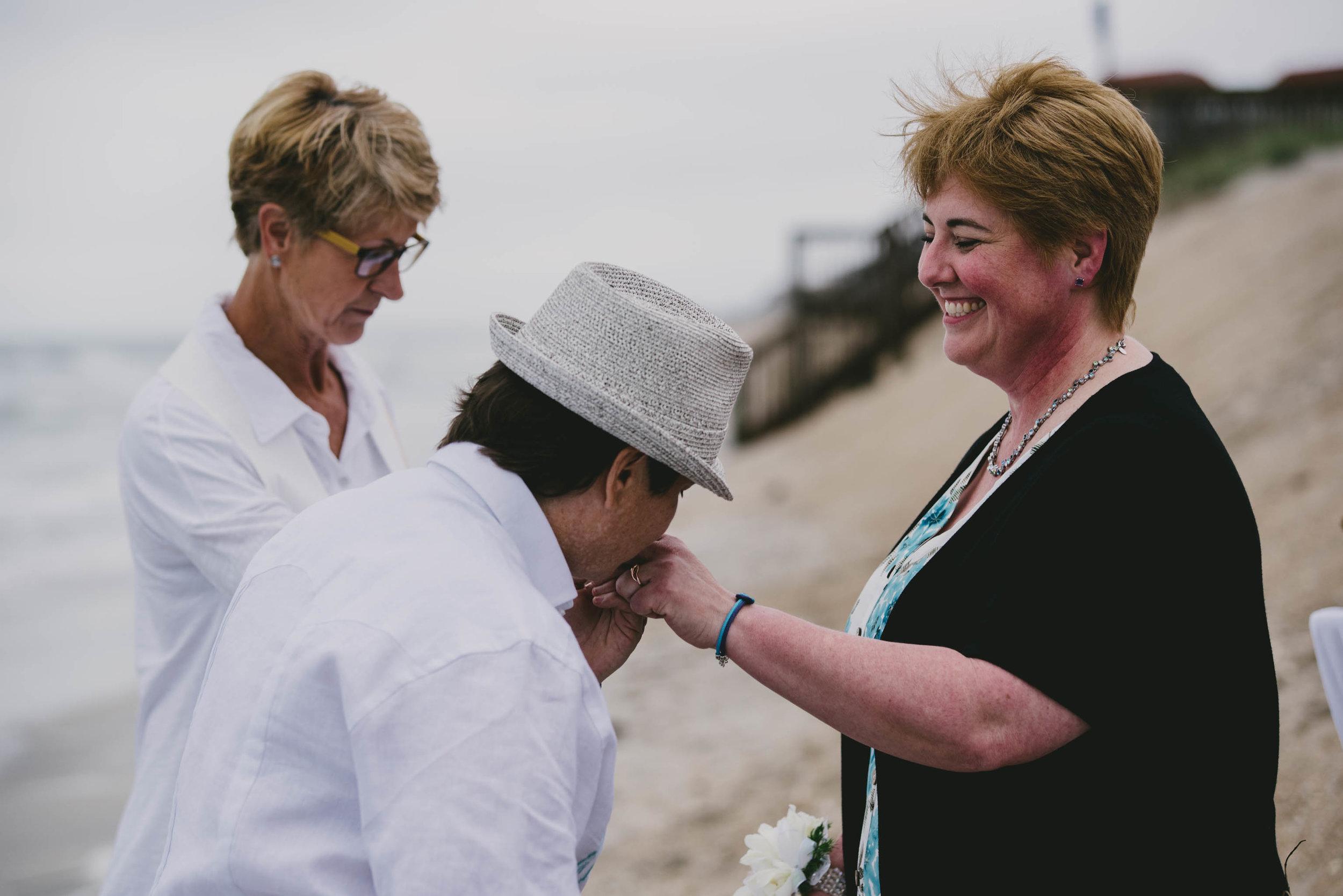 topsail-island-same-sex-beach-wedding-echange-of-rings-photo.jpg