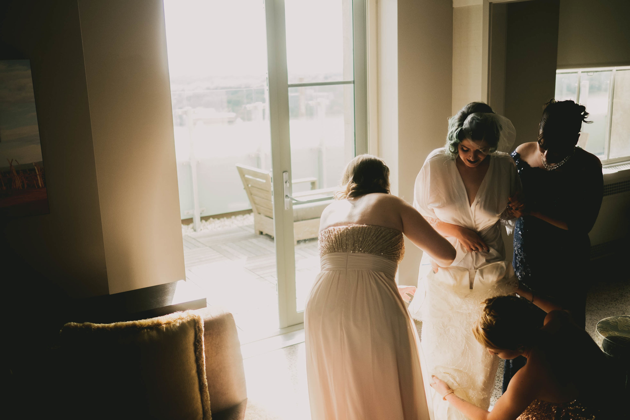 21c-hotel-durham-offbeat-wedding-bride-gettting-into-dress.jpg