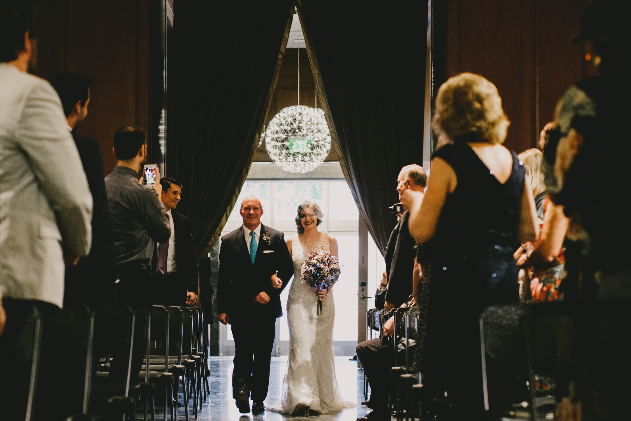 21c-hotel-durham-offbeat-wedding-ceremony-bride-and-father.jpg