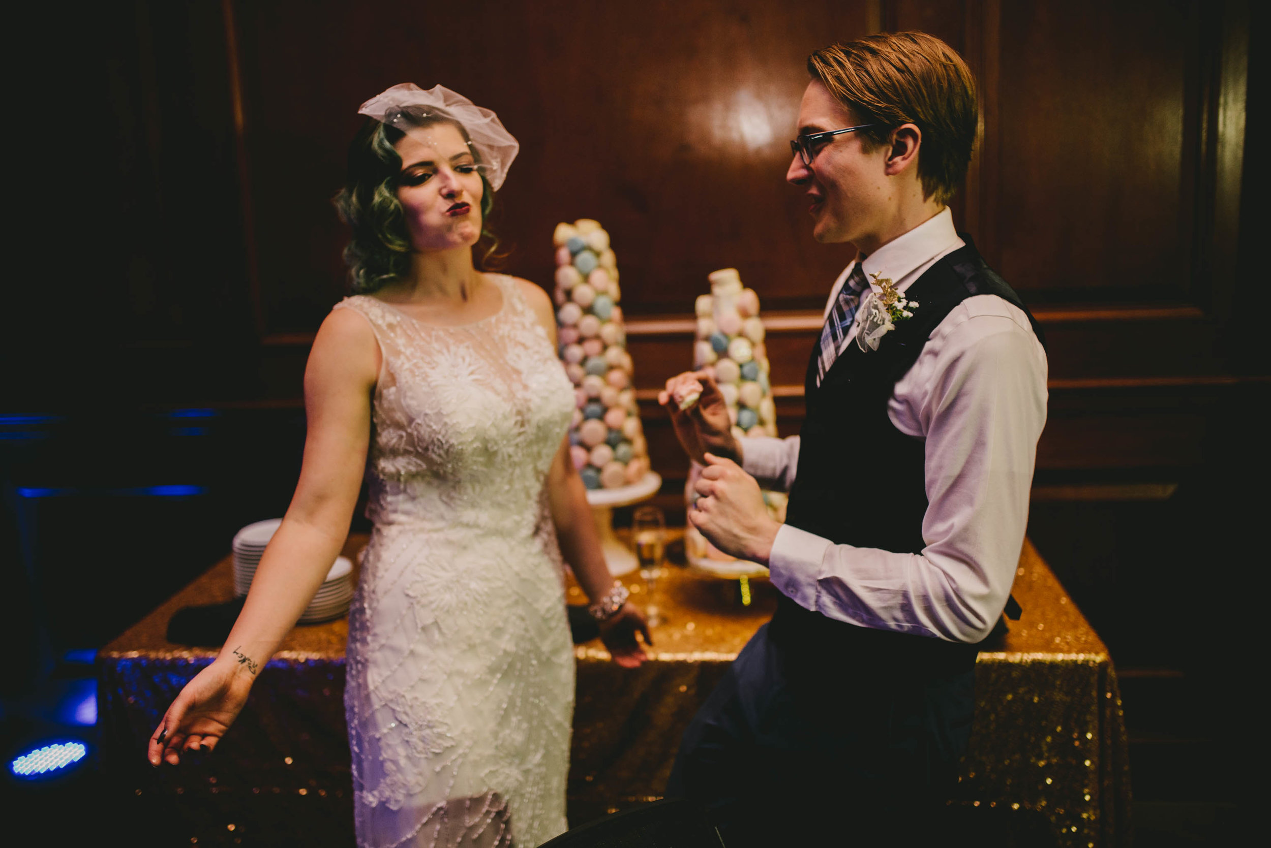 21c-hotel-durham-offbeat-wedding-macaron-cake-cutting.jpg