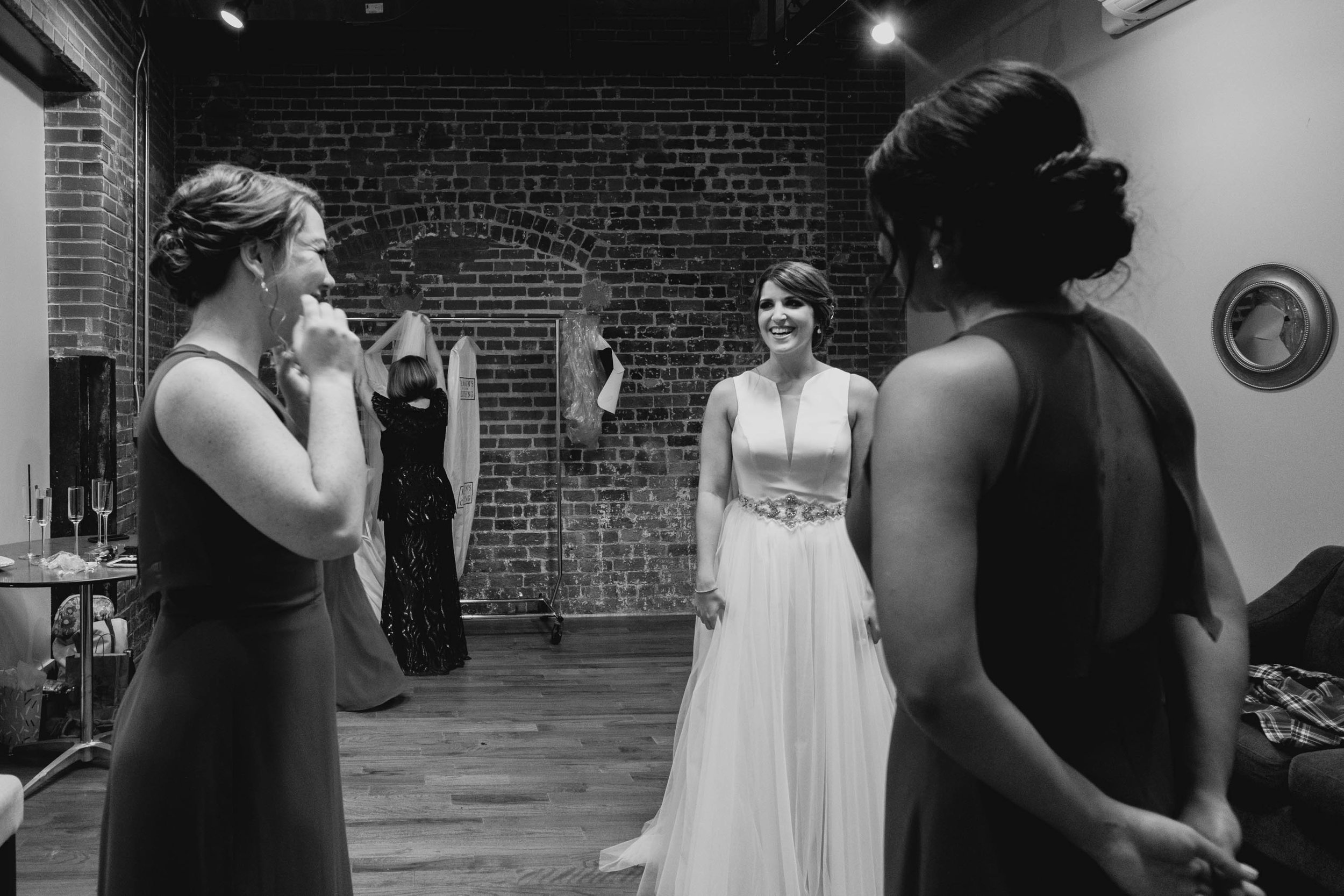 bridesmaids and bride talking before wedding