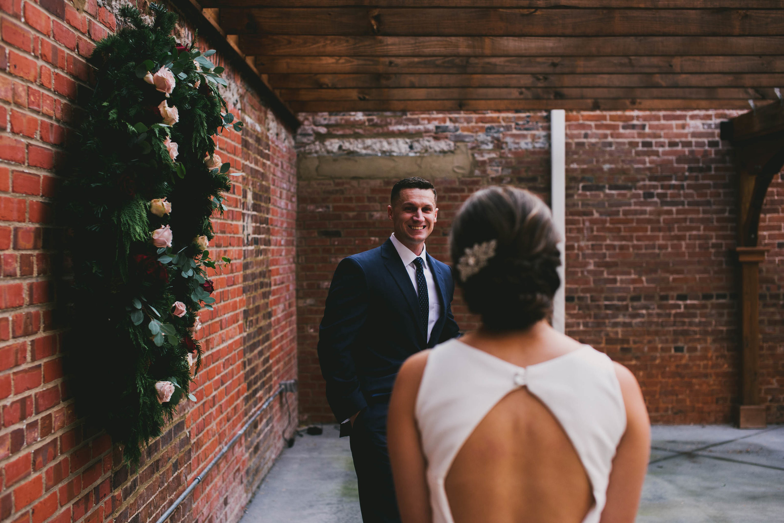 first look between the groom and the bride