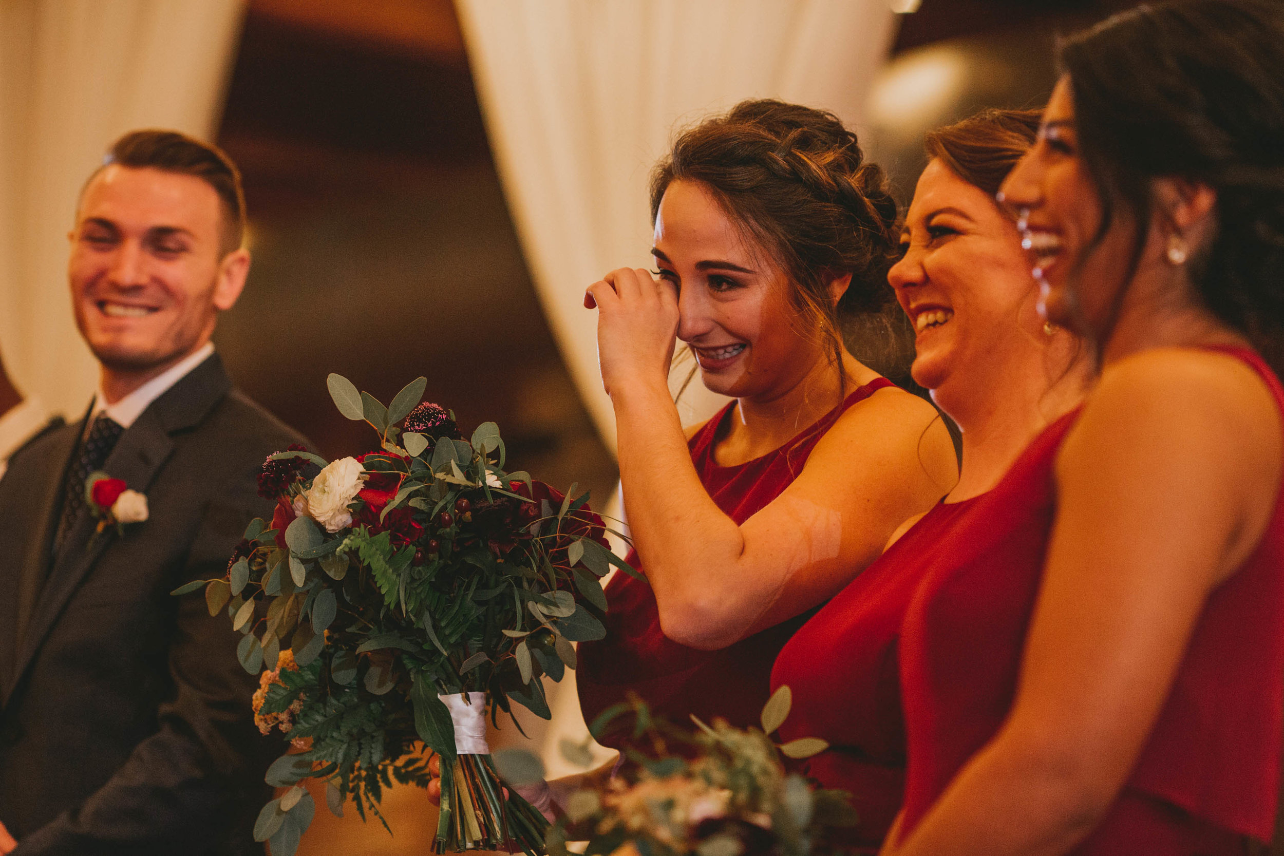 bridesmaid crying during bride and groom first dance