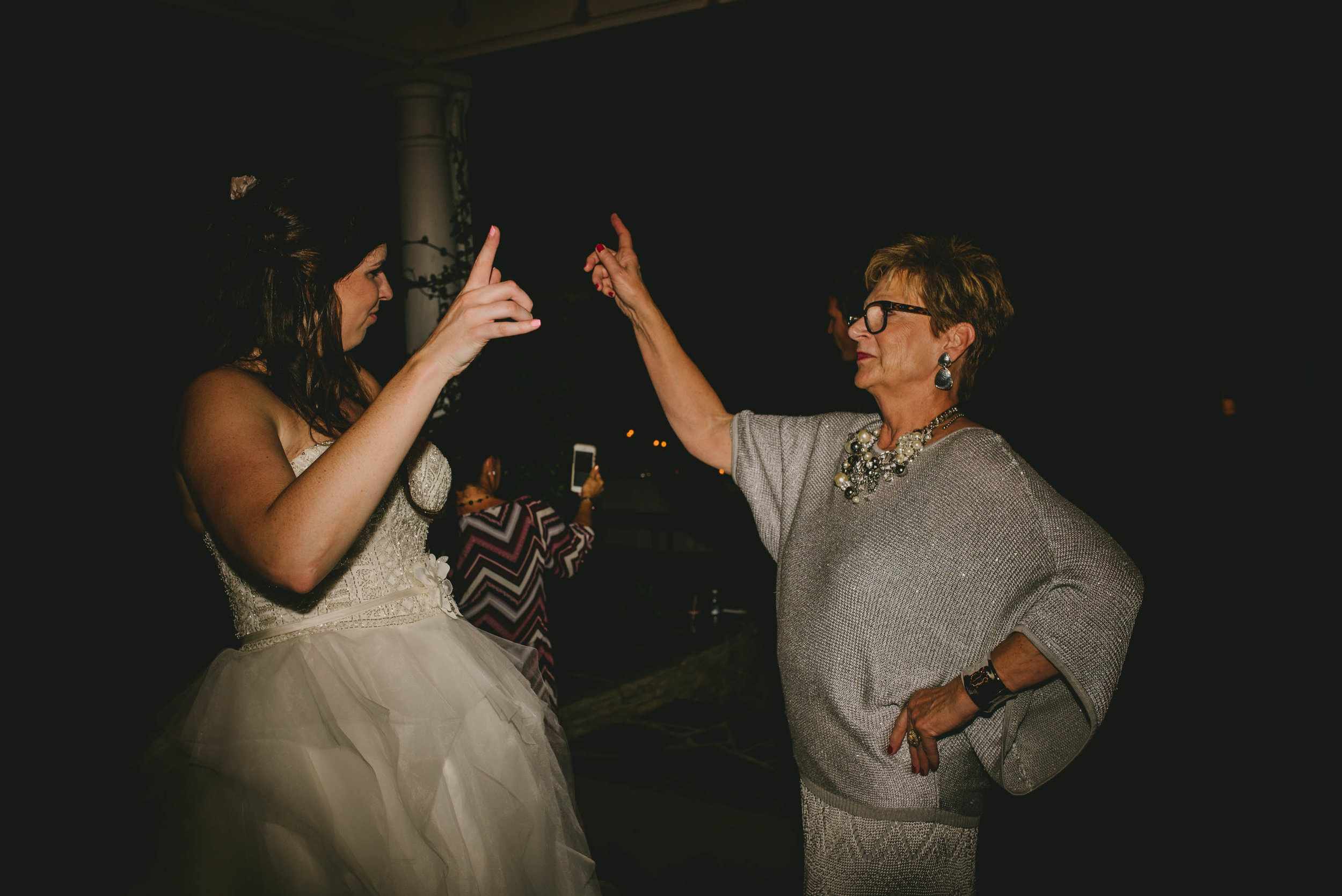 bride and her mom dancing during wedding reception at mims house