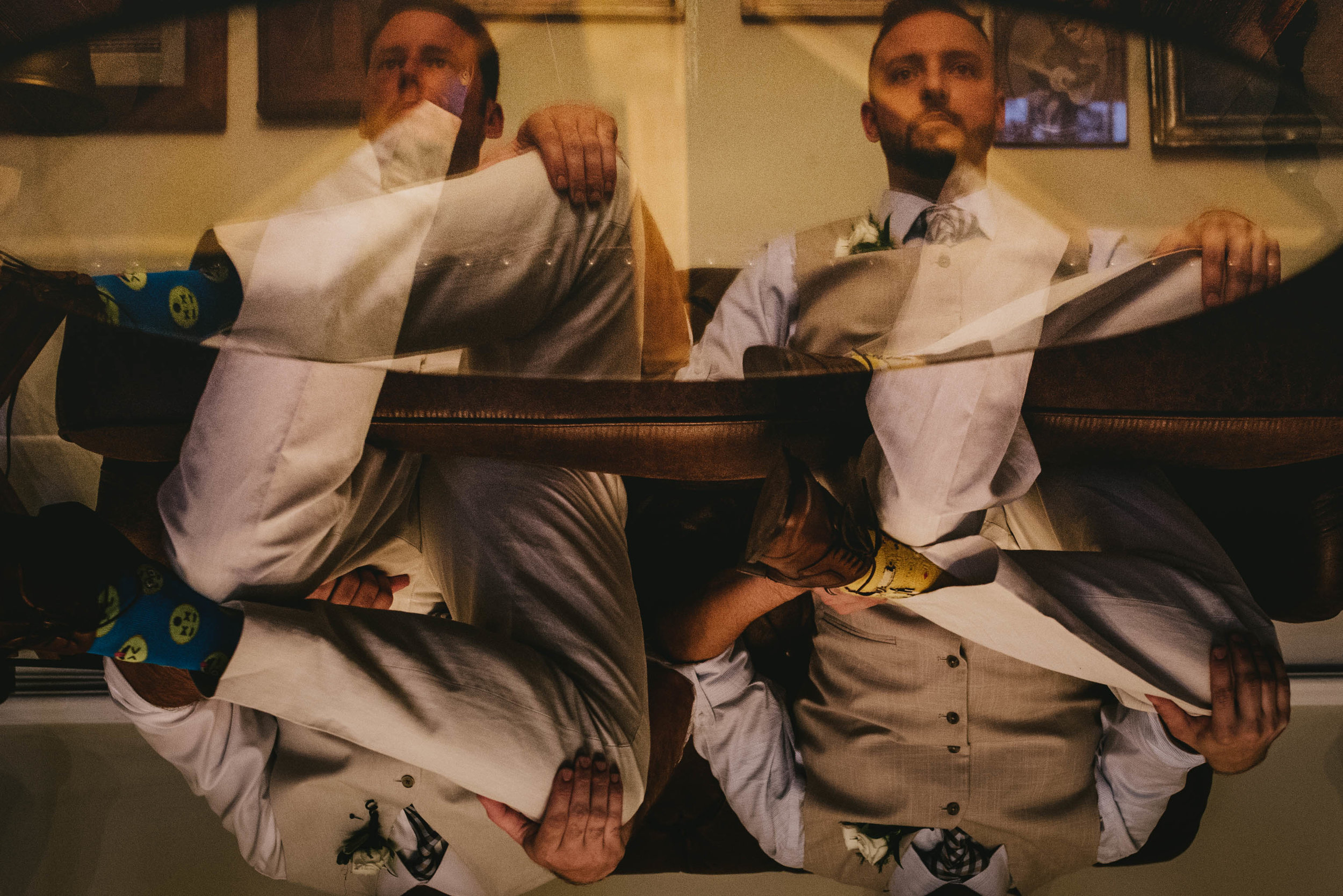 reflective portrait of groom and best man before mims house wedding