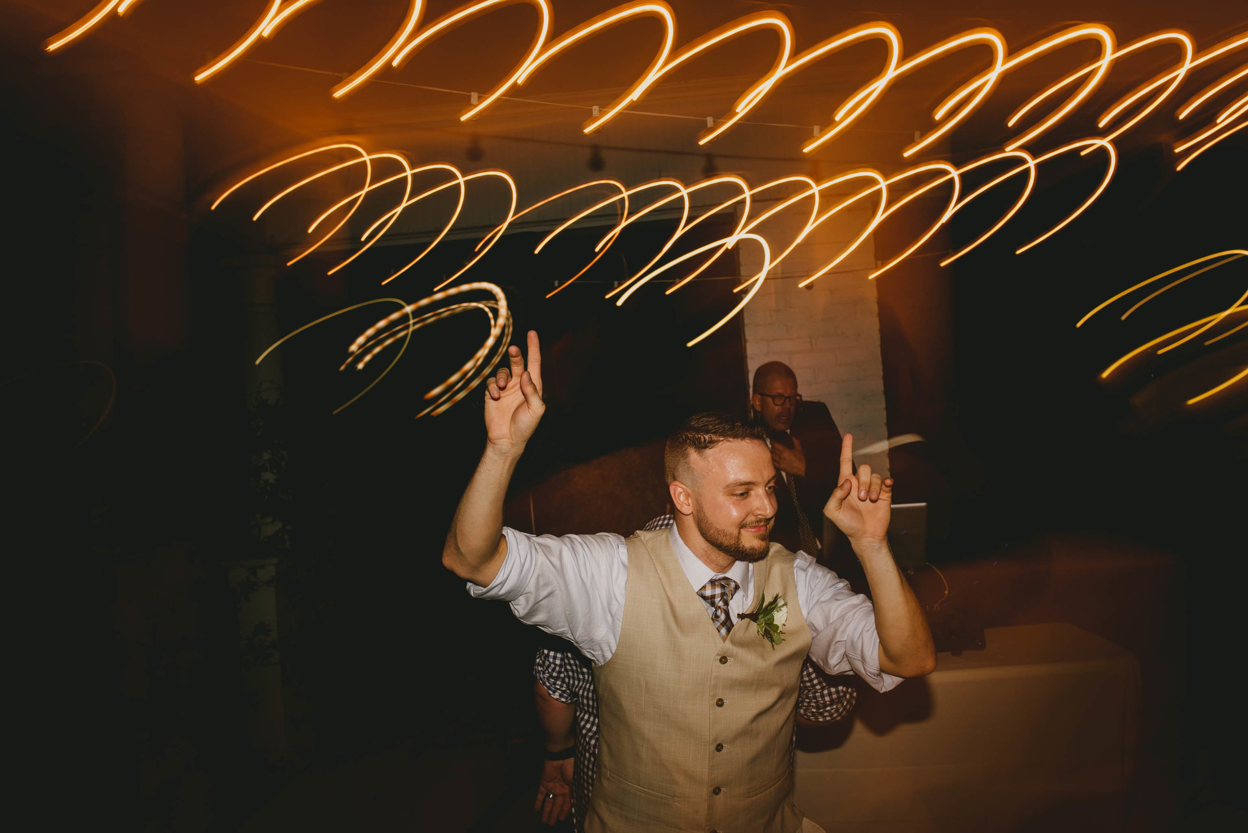 groom dancing during wedding reception at mims house