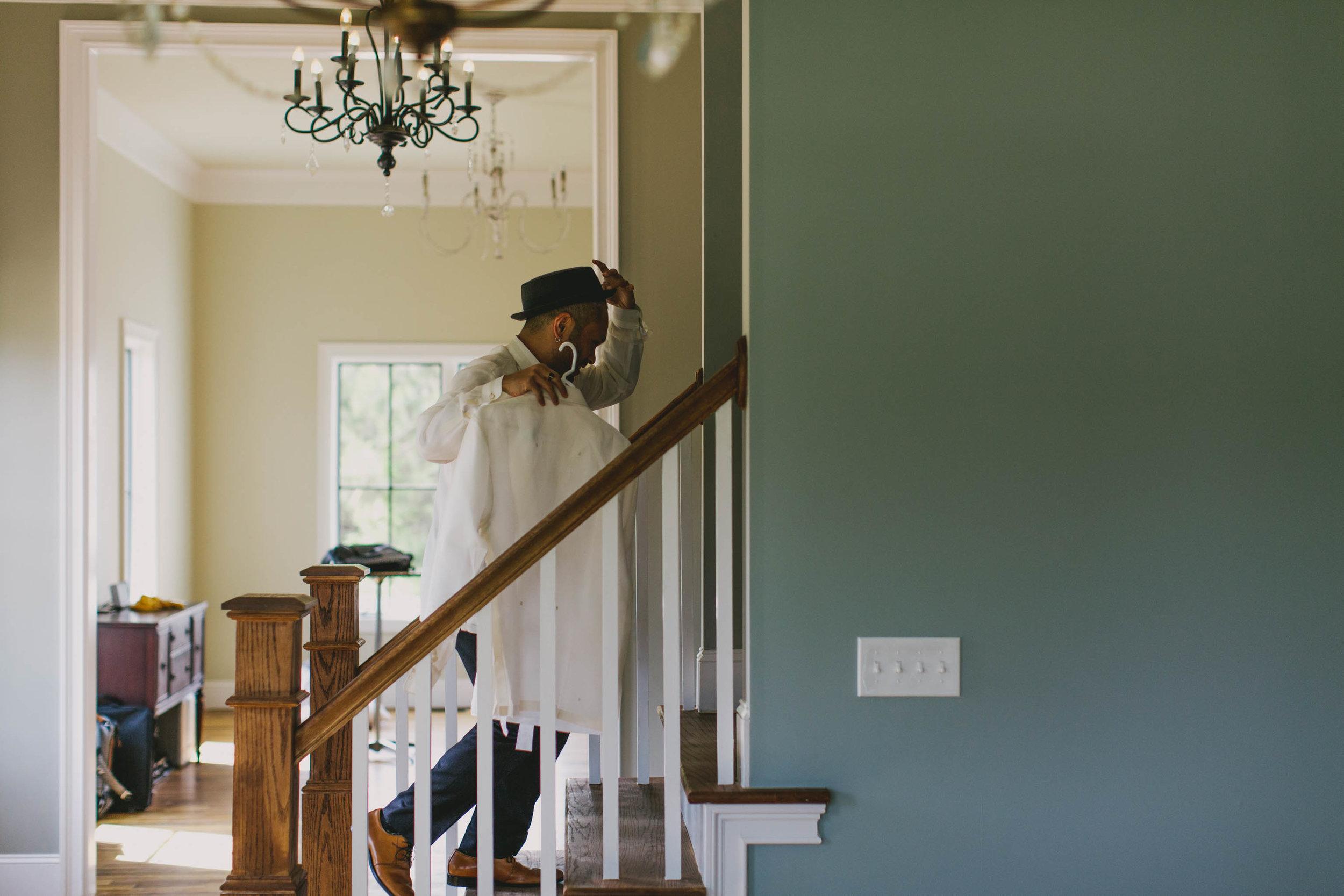 groom running upstairs to change before wedding