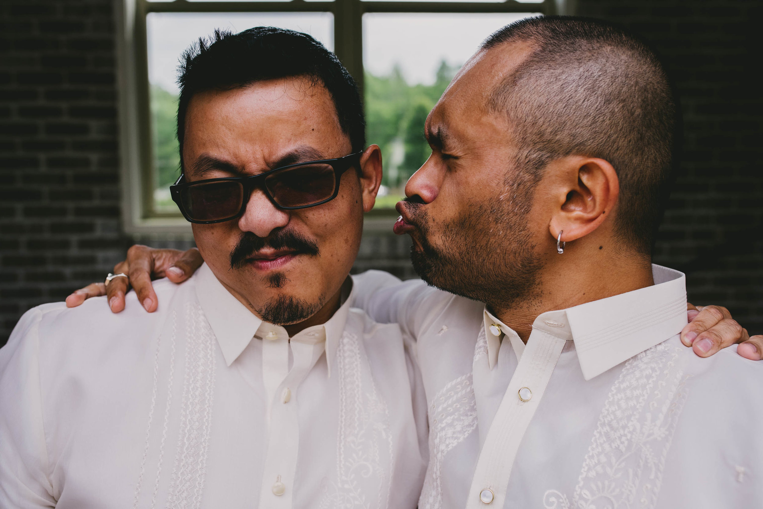groom and his best man acting silly