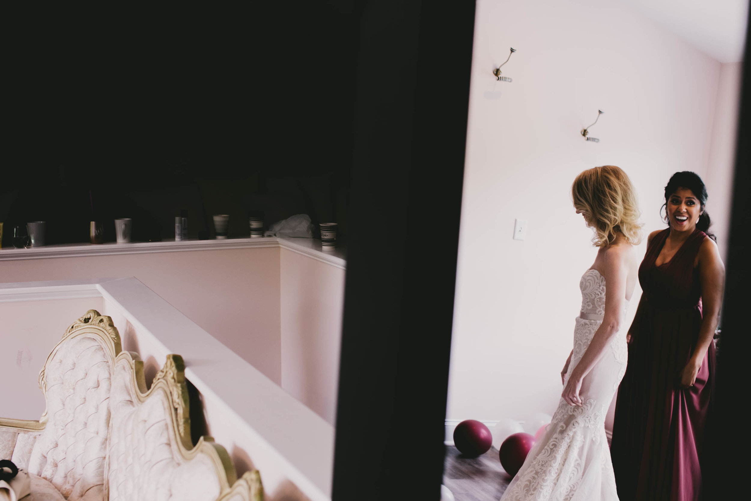 a reflection of the bride as she is getting ready
