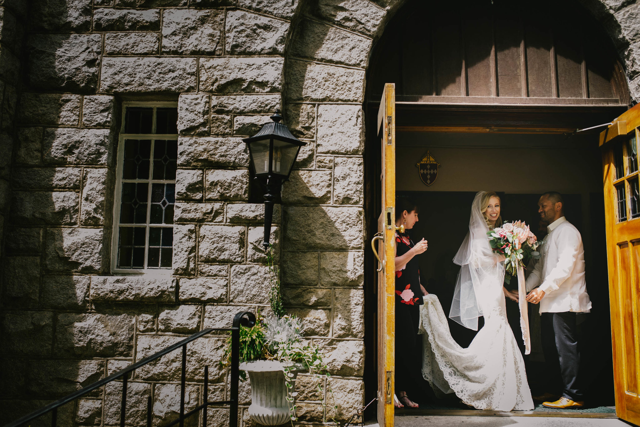 bride being readied before walking out of Sacred Heart Cathedral
