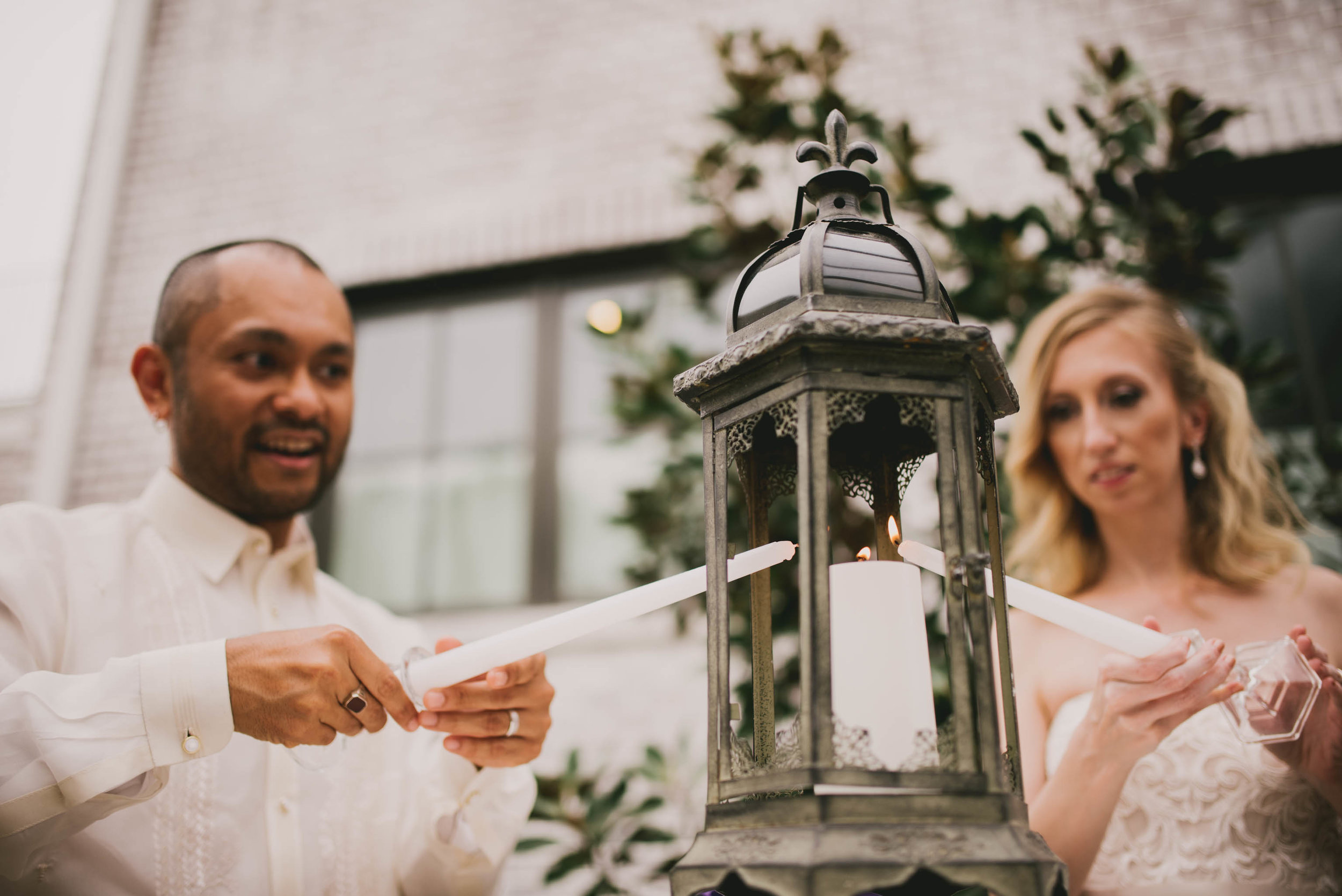 bride and groom performing candle lighting ceremony before dinner