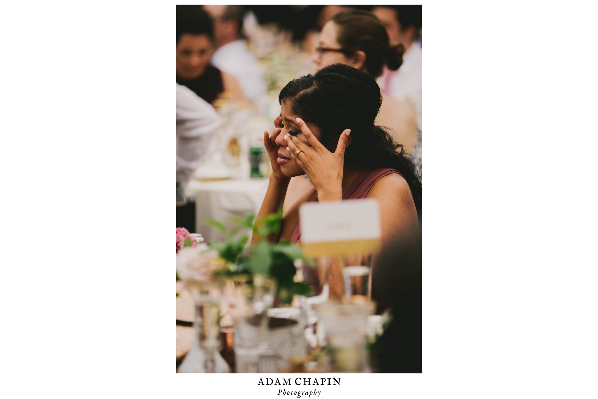 bridesmaid crying during bride and groom speeches