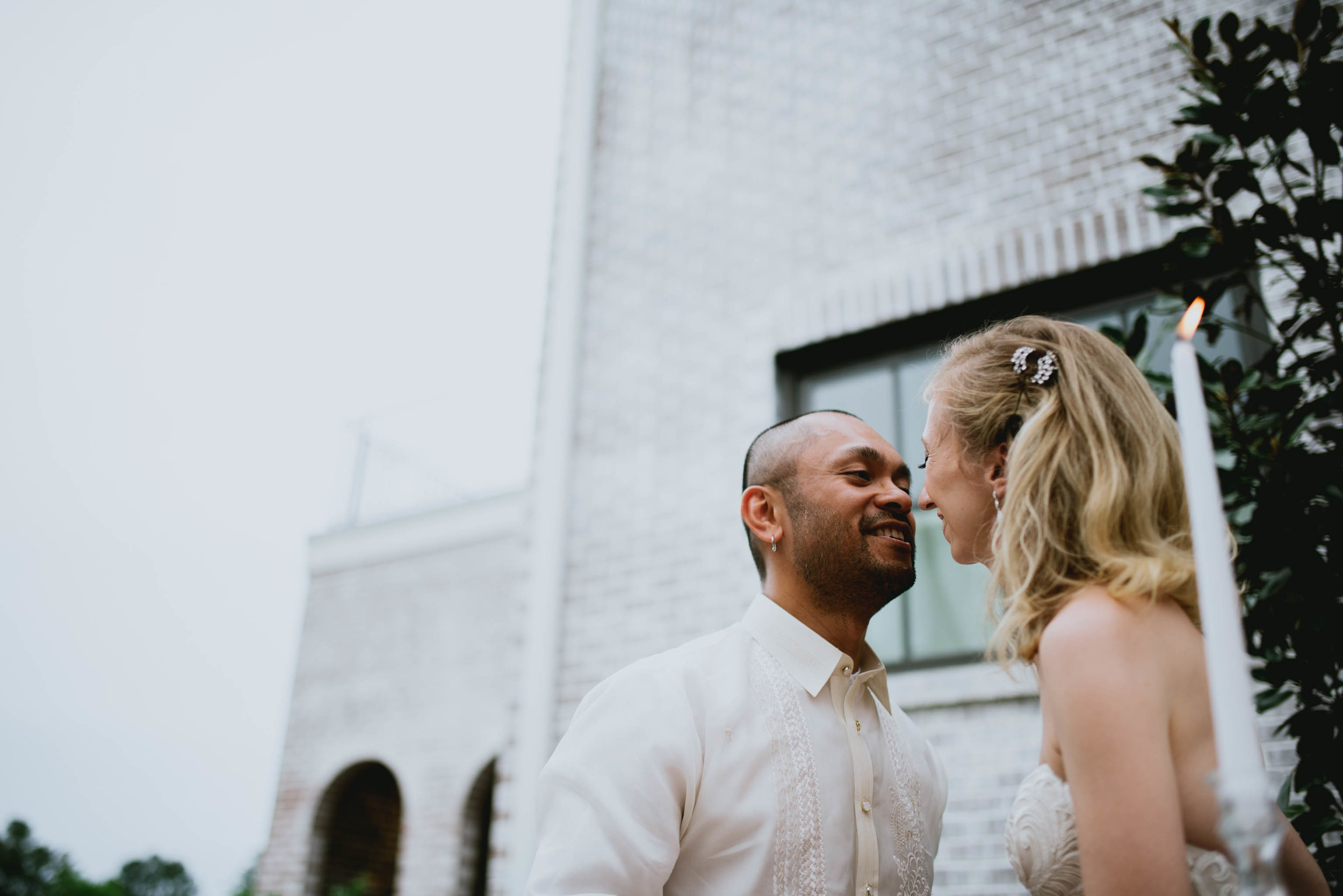 bride and groom share a sweet kiss during reception