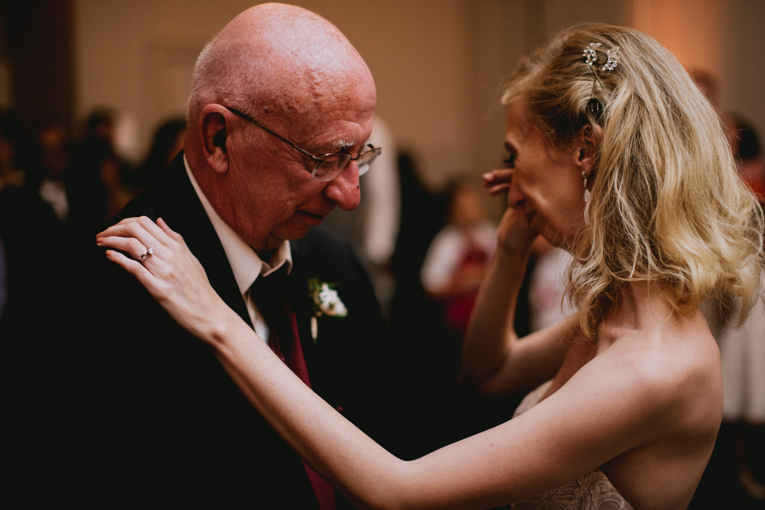 bride crying while sharing in first dance with her father