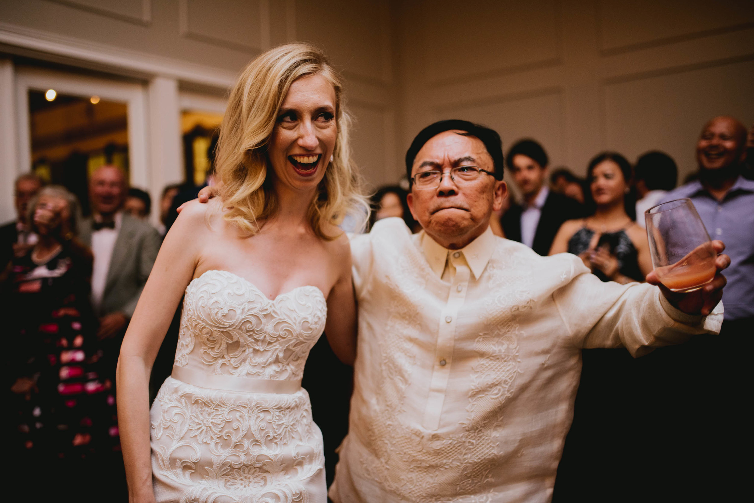 bride and groom's father share a dance