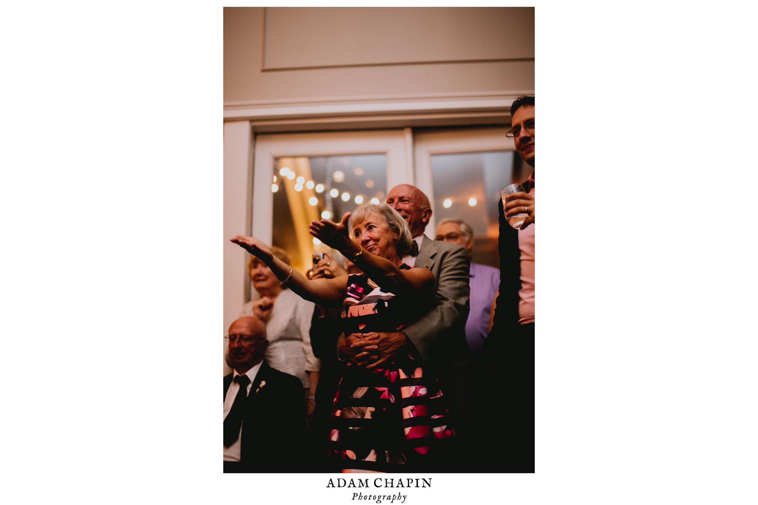 wedding guests cheering on bride
