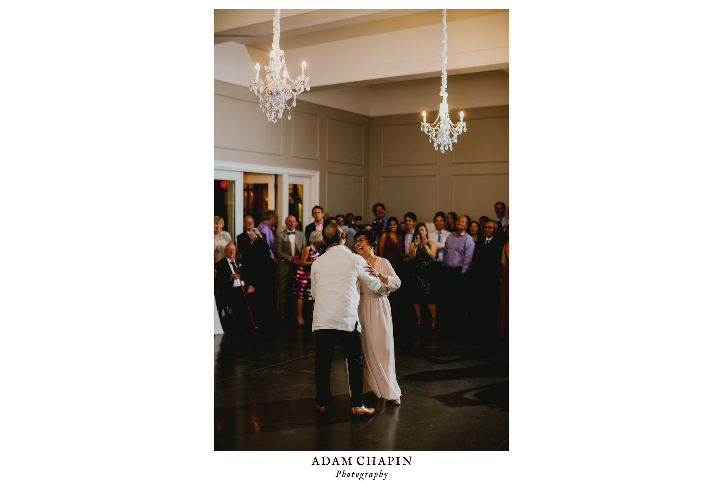 mother and groom dance during wedding reception
