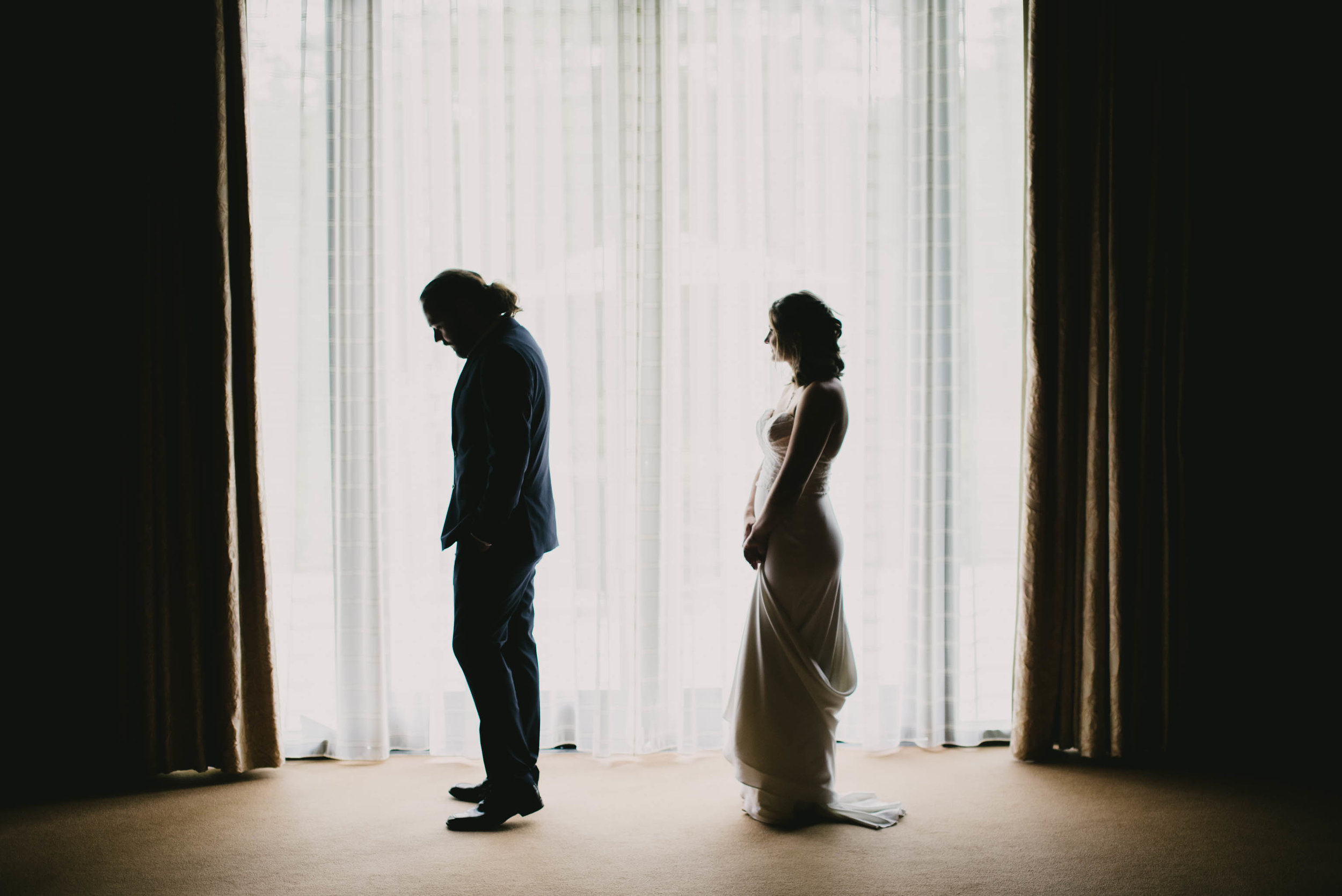 bride and groom getting ready to see one another before their ceremony at The Umstead Hotel and Spa