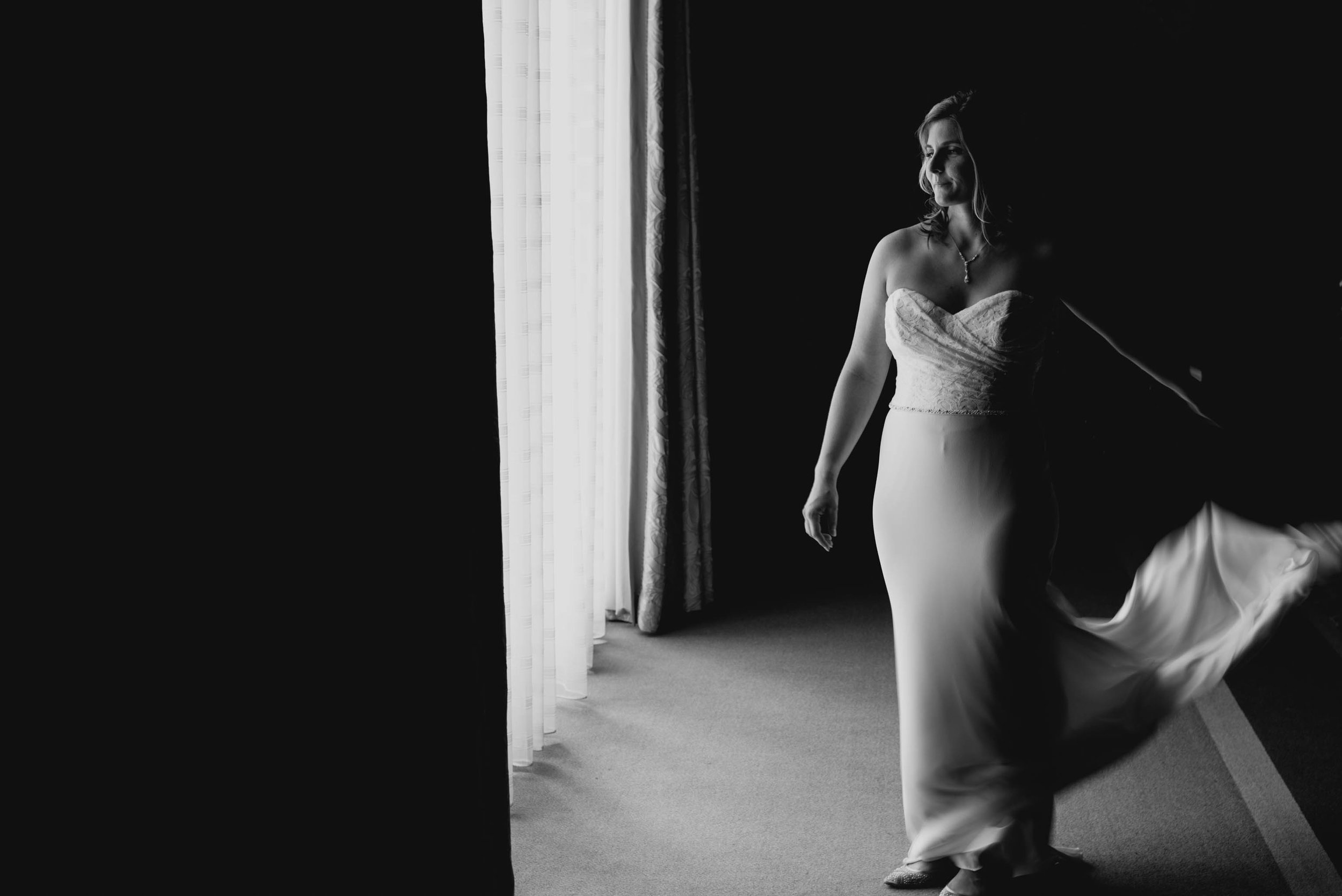 bride tossing her dress train down at the Umstead Hotel and Spa