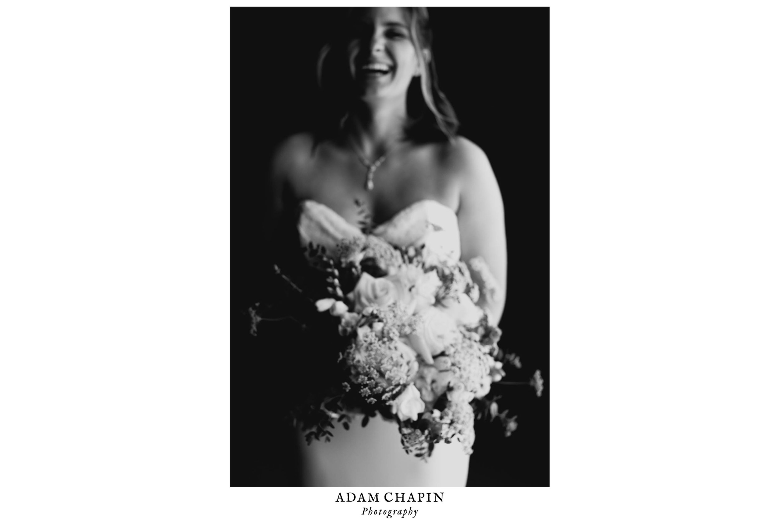 bride laughing while holding bouquet at The Umstead Hotel and Spa