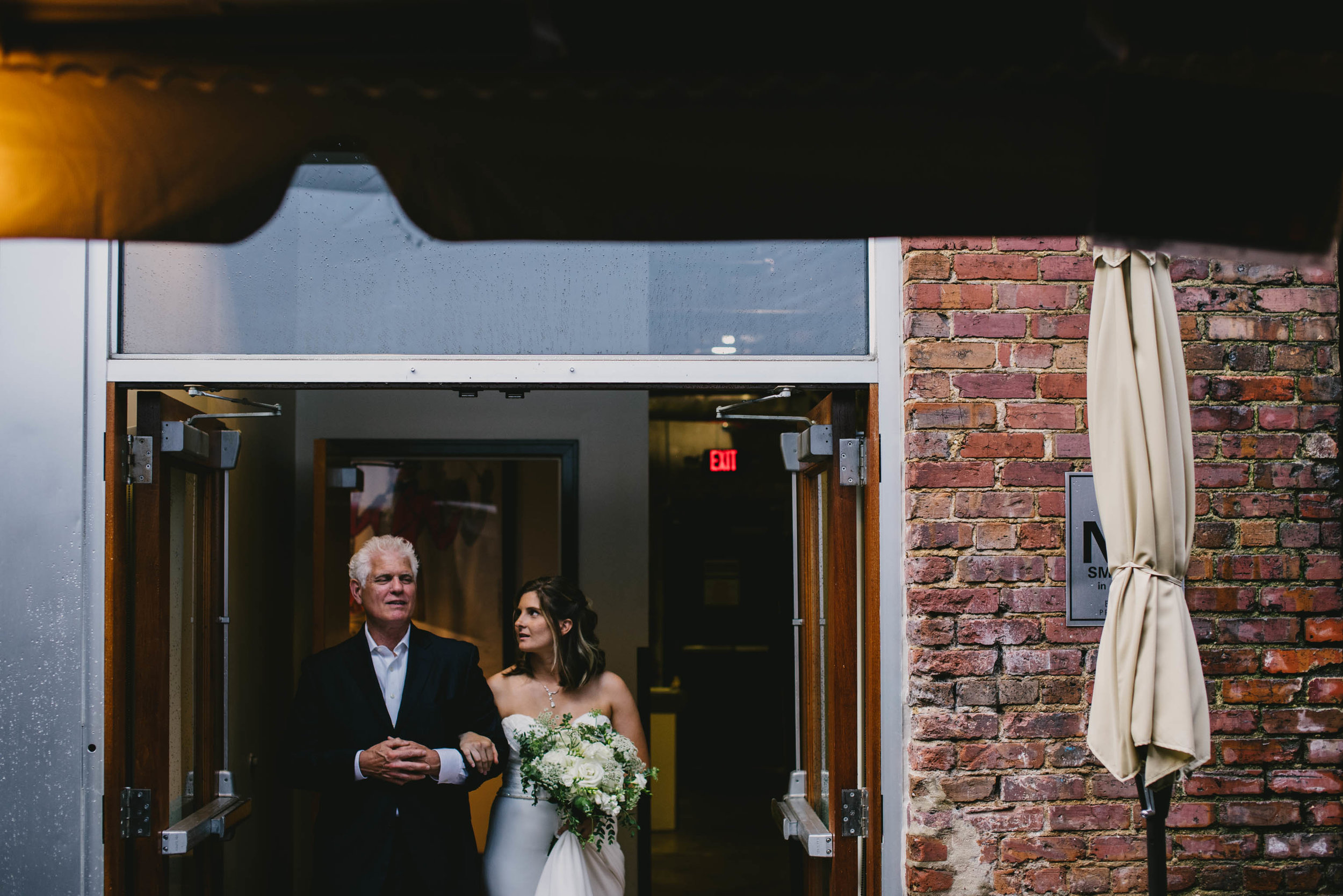 bride getting ready to walk down aisle with her father at her Jiddi Space and Courtyard Wedding at Sitti Restaurant