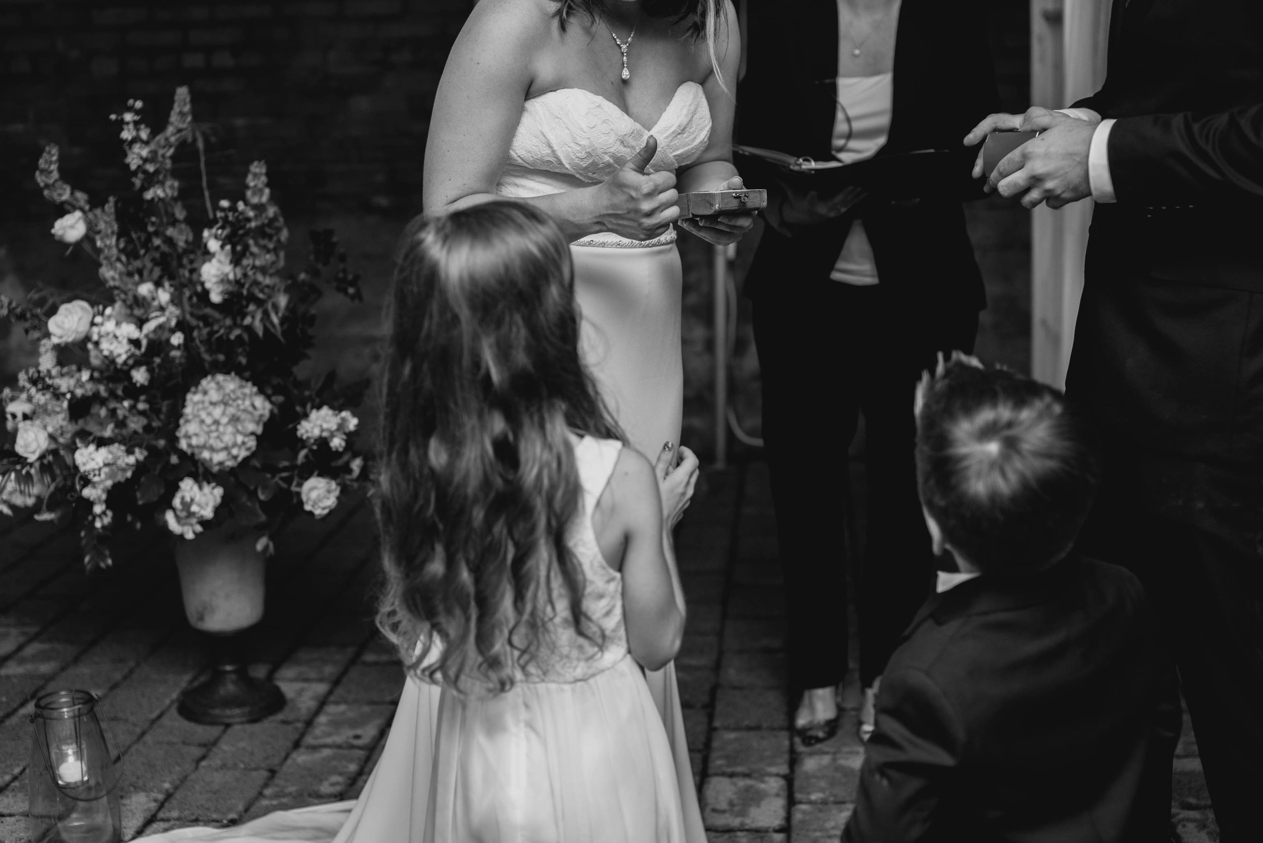 ring bearers handing off the rings during ceremony of this Jiddi Space and Courtyard Wedding at Sitti Restaurant