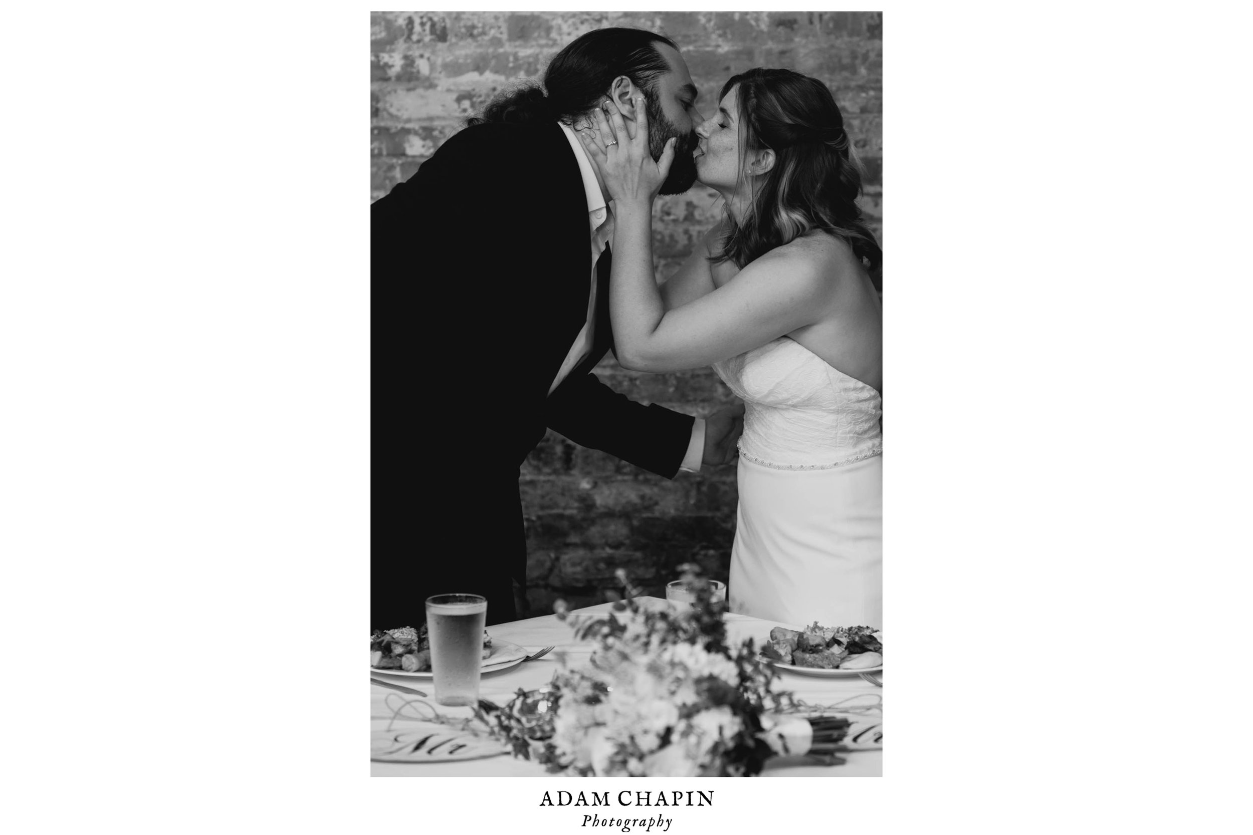 bride and groom sharing a kiss during their Jiddi Space and Courtyard Wedding at Sitti Restaurant