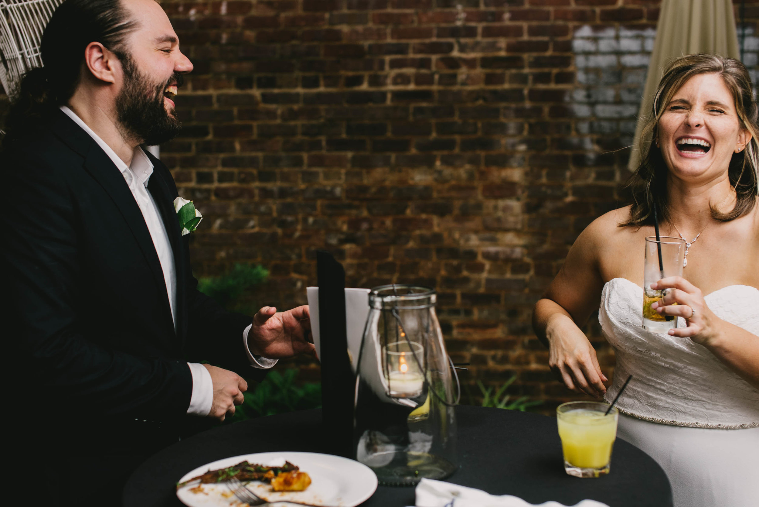 bride and groom laughing during their Jiddi Space and Courtyard Wedding at Sitti Restaurant