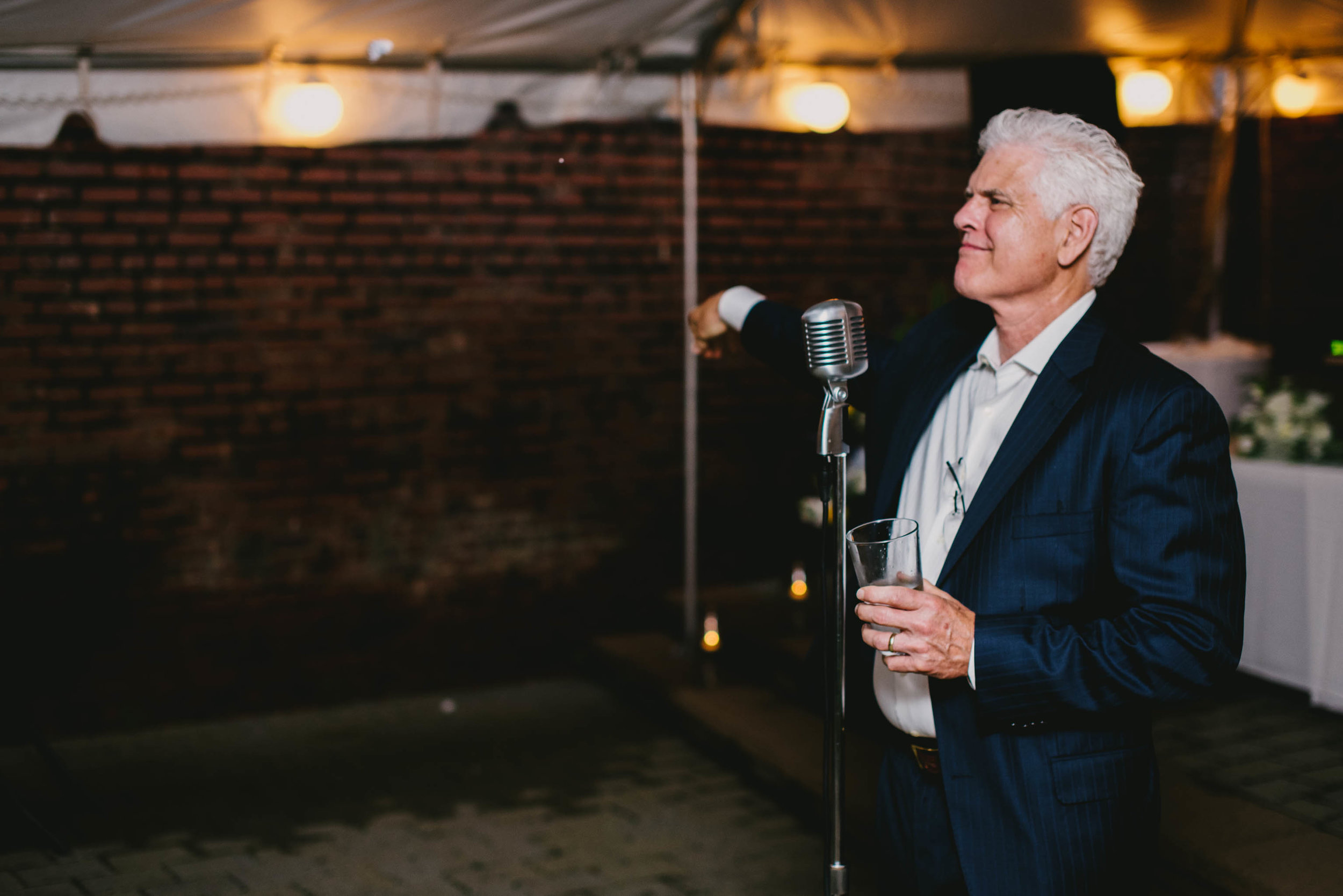 father of the bride tossing away planned speech during toast at this Jiddi Space and Courtyard Wedding at Sitti Restaurant