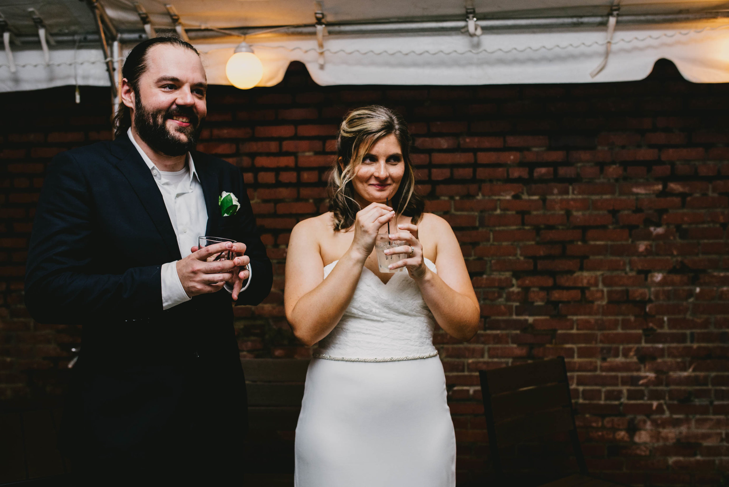 bride and groom laughing during toasts at their Jiddi Space and Courtyard Wedding at Sitti Restaurant