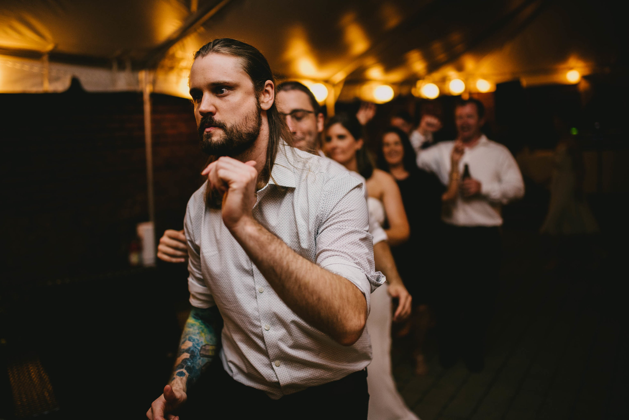guests start dance train during this Jiddi Space and Courtyard Wedding at Sitti Restaurant