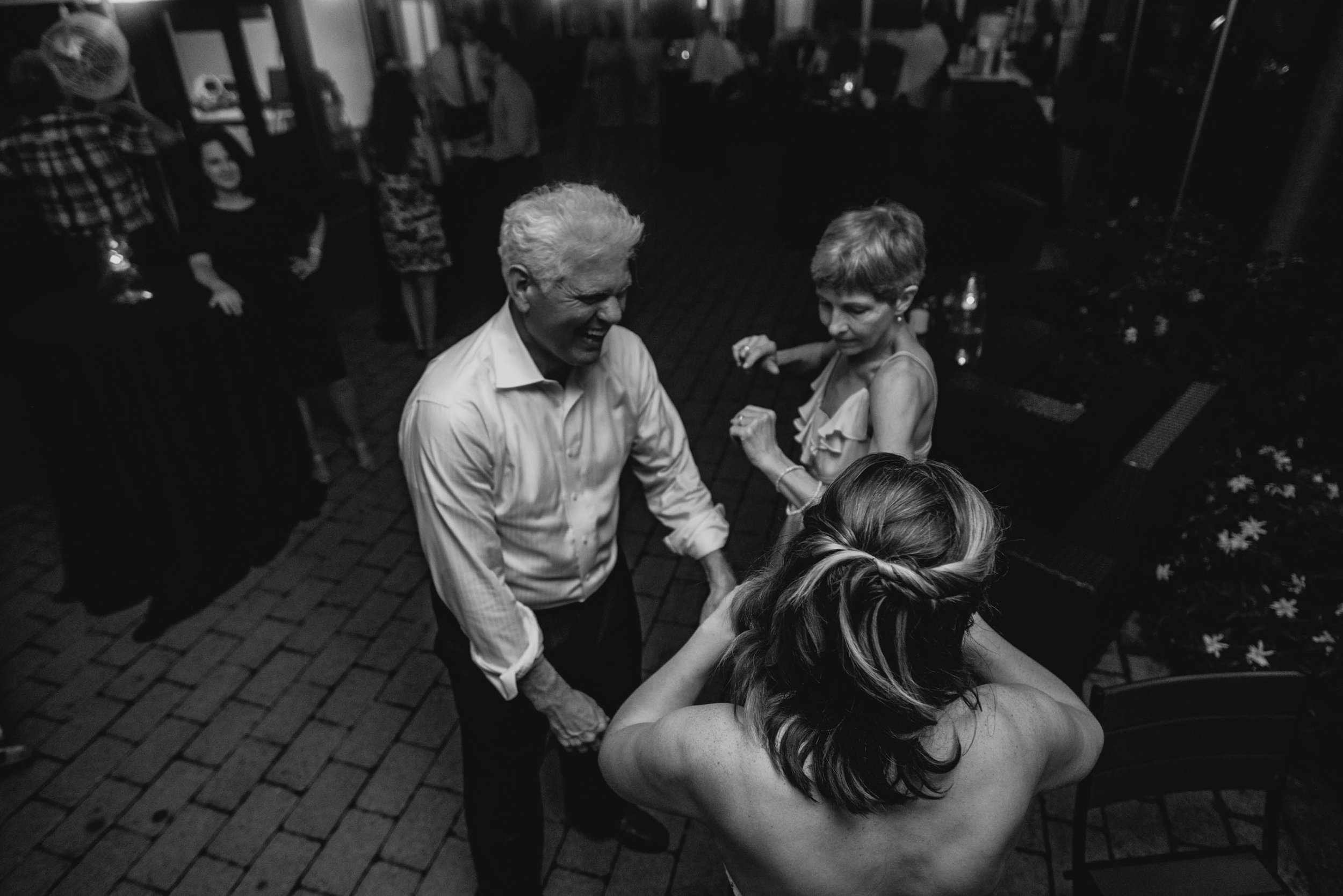 brides parent dancing with bride during reception at Jiddi Space and Courtyard Wedding at Sitti Restaurant