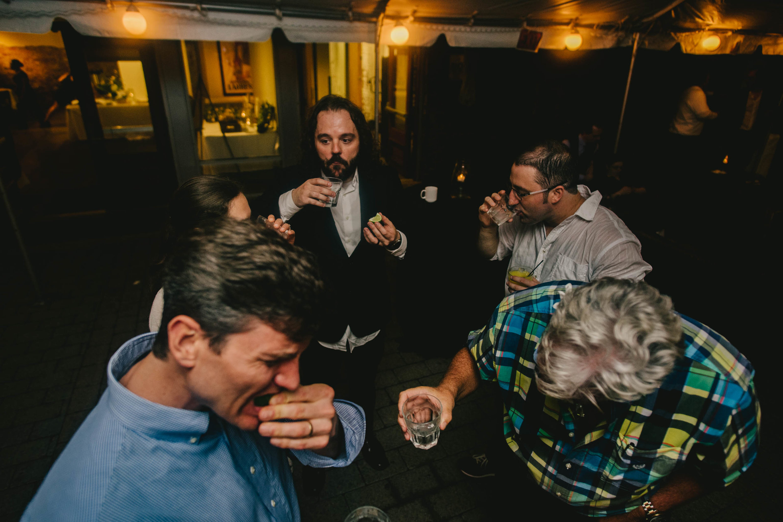 groom and guests taking tequila shot during their Jiddi Space and Courtyard Wedding at Sitti Restaurant