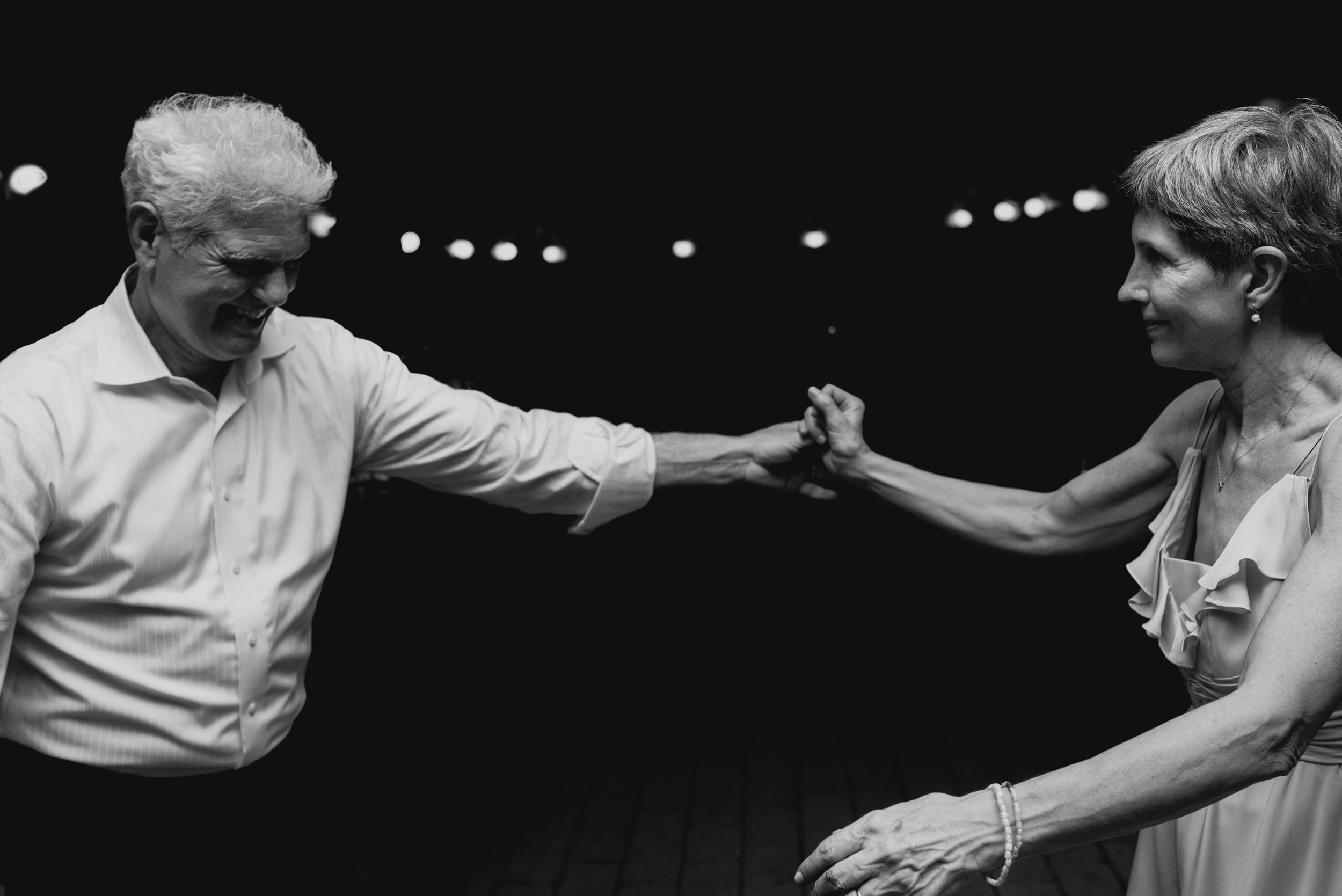 bride's mom and dad dancing during reception at this Jiddi Space and Courtyard Wedding at Sitti Restaurant