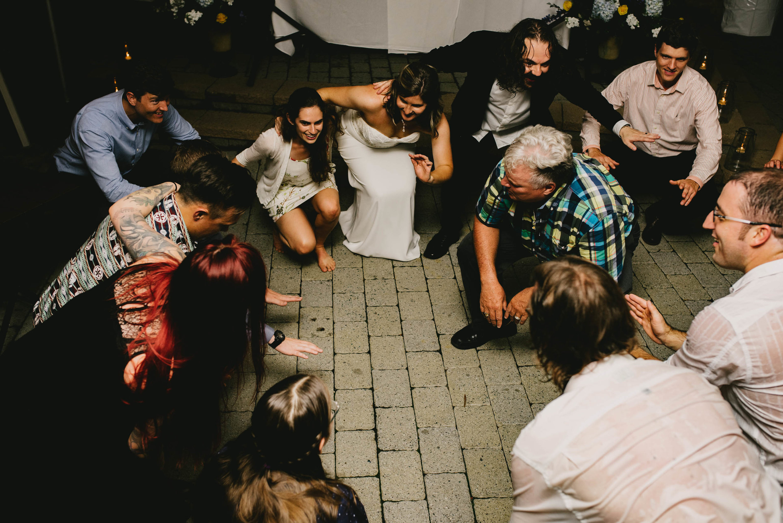 wedding guests getting low to shout at this Jiddi Space and Courtyard Wedding at Sitti Restaurant