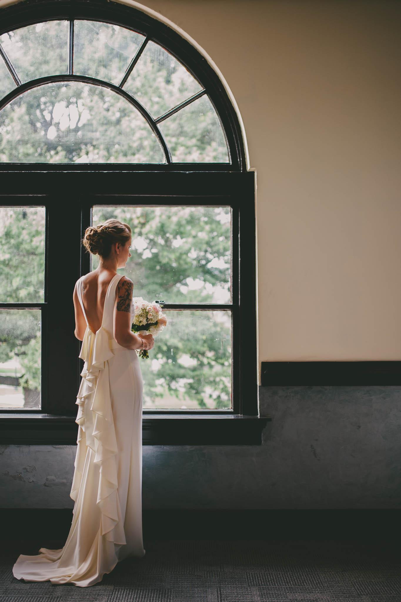 bride waiting by window before 214 martin street wedding