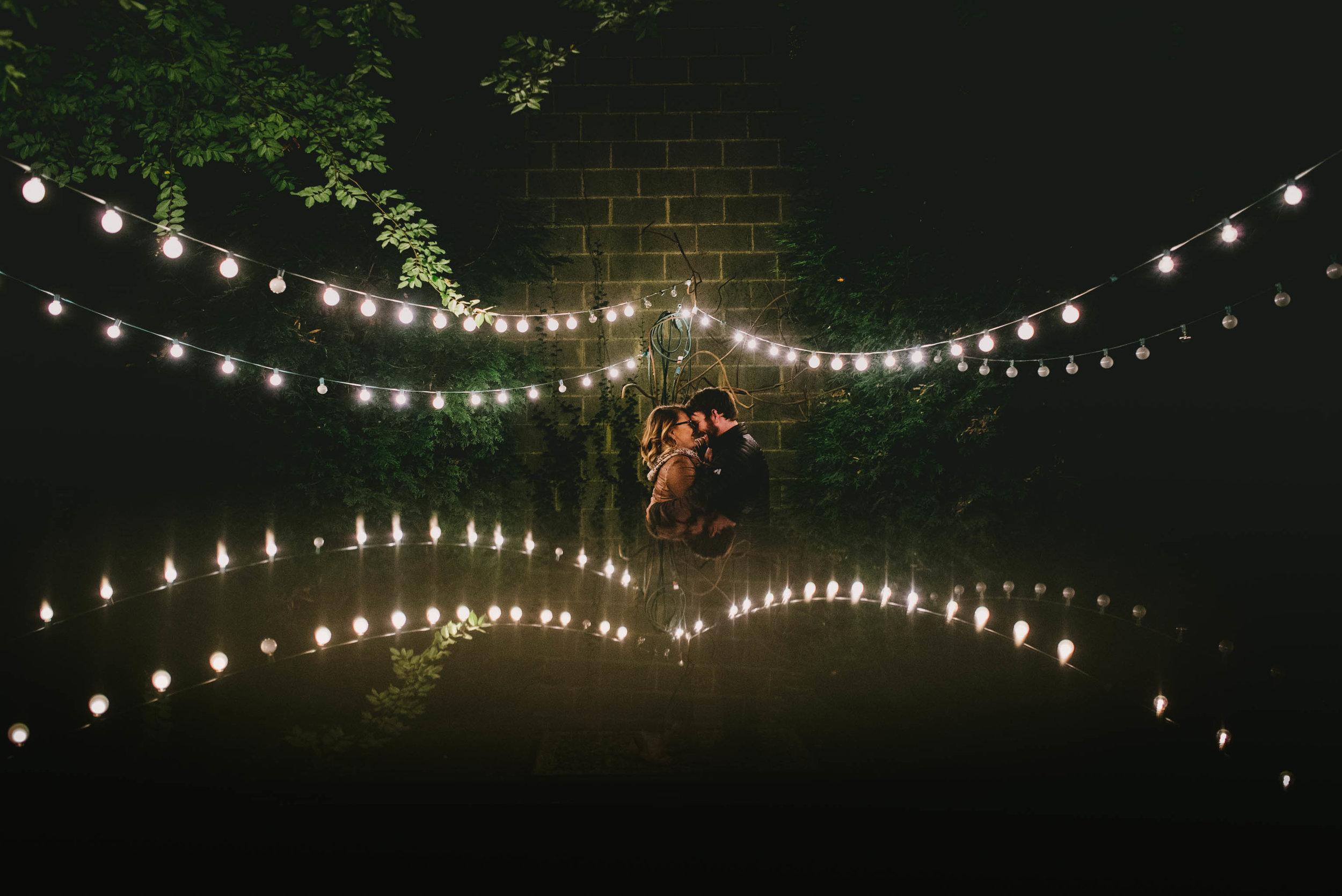 couple under the market lights of Lindley Park Filling Station