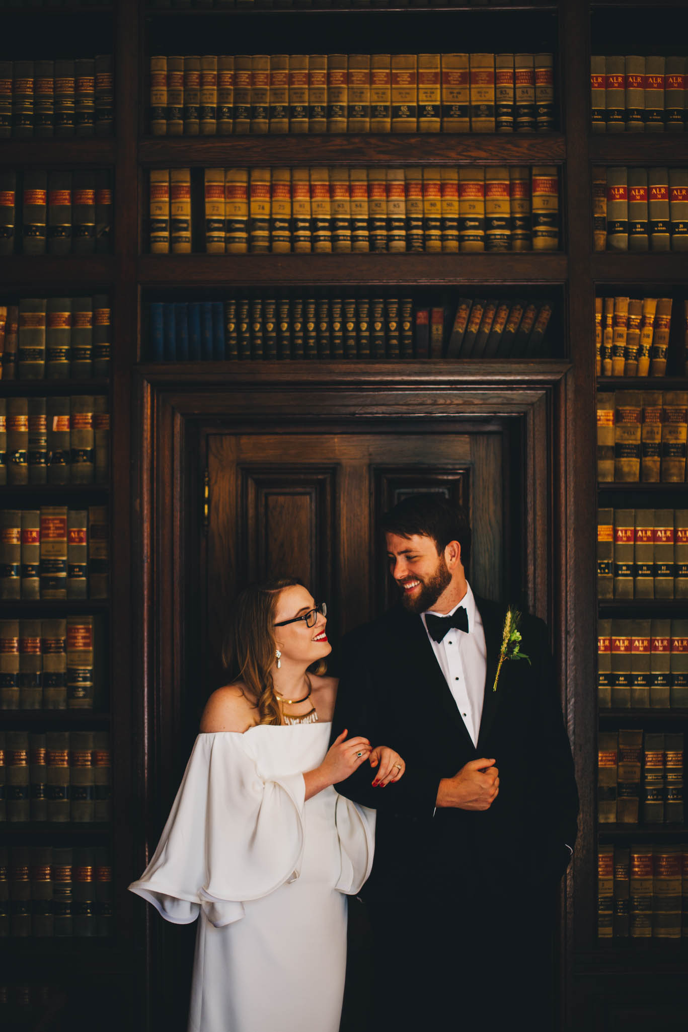 couple embraced in the library of the graylyn mansion in winston-salem nc