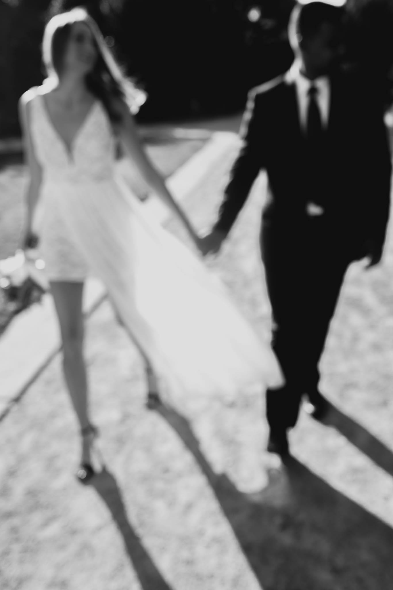 bride and groom walking through jc raulston arboretum in raleigh during their elopement