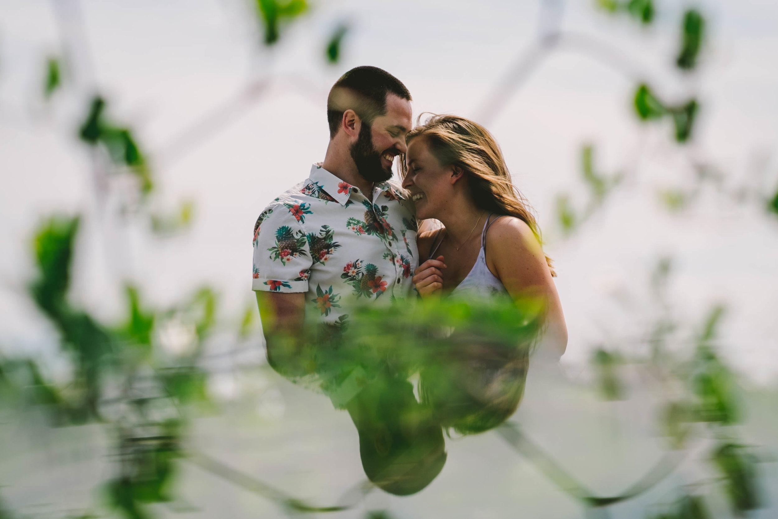 couple laughing together during engagement session at carolina beach