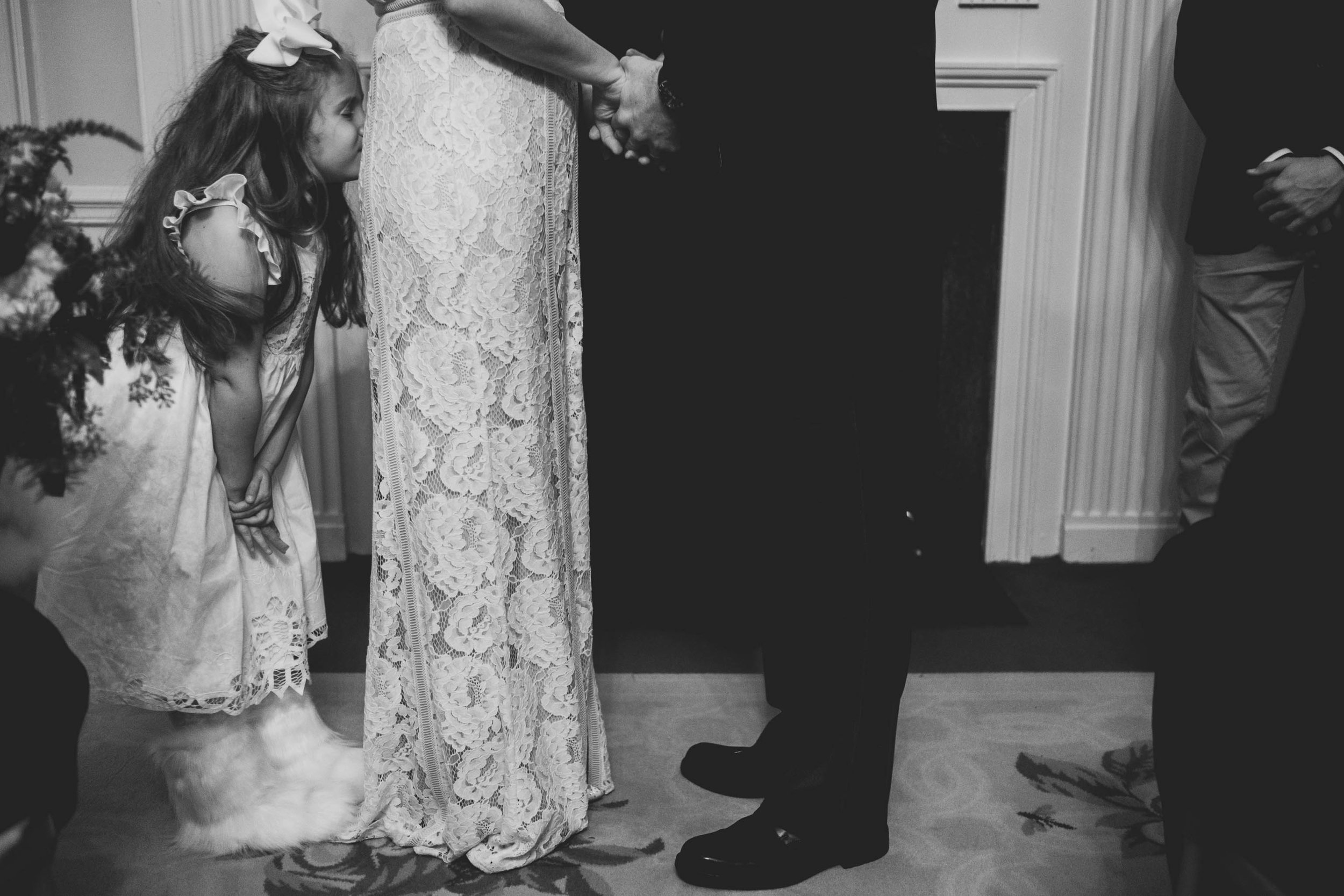 brides daughter kissing her butt during the ceremony at the Carolina Inn
