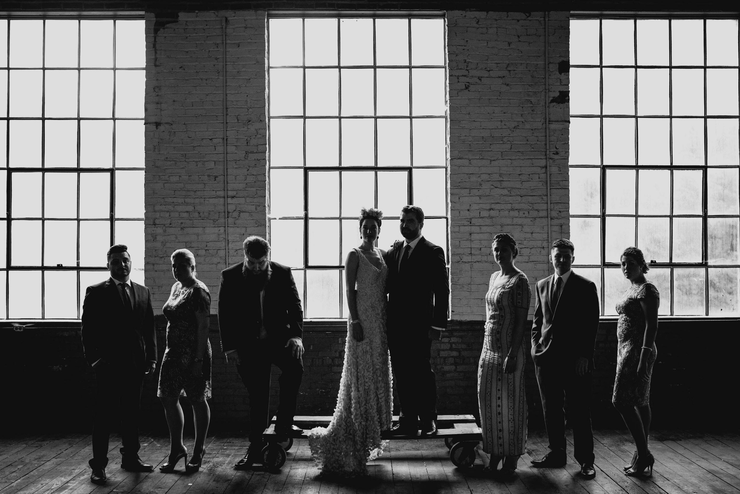 bad ass wedding party formal photo at forest hall at chatham mills