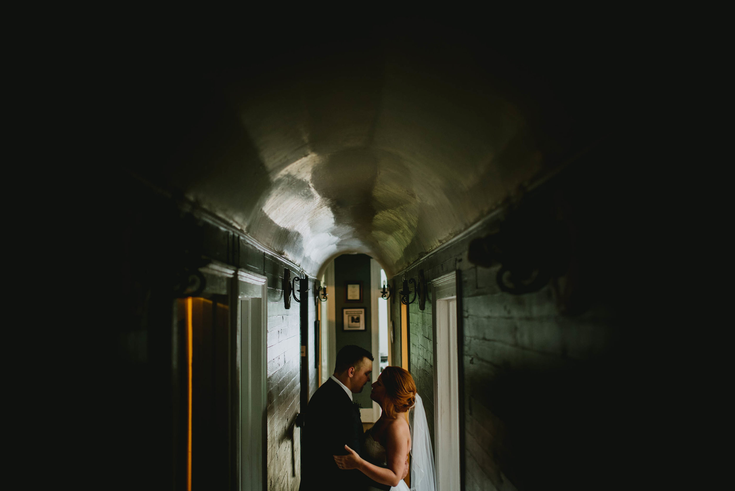 couple embracing in a hallway after their Mims House wedding in Holly Springs NC