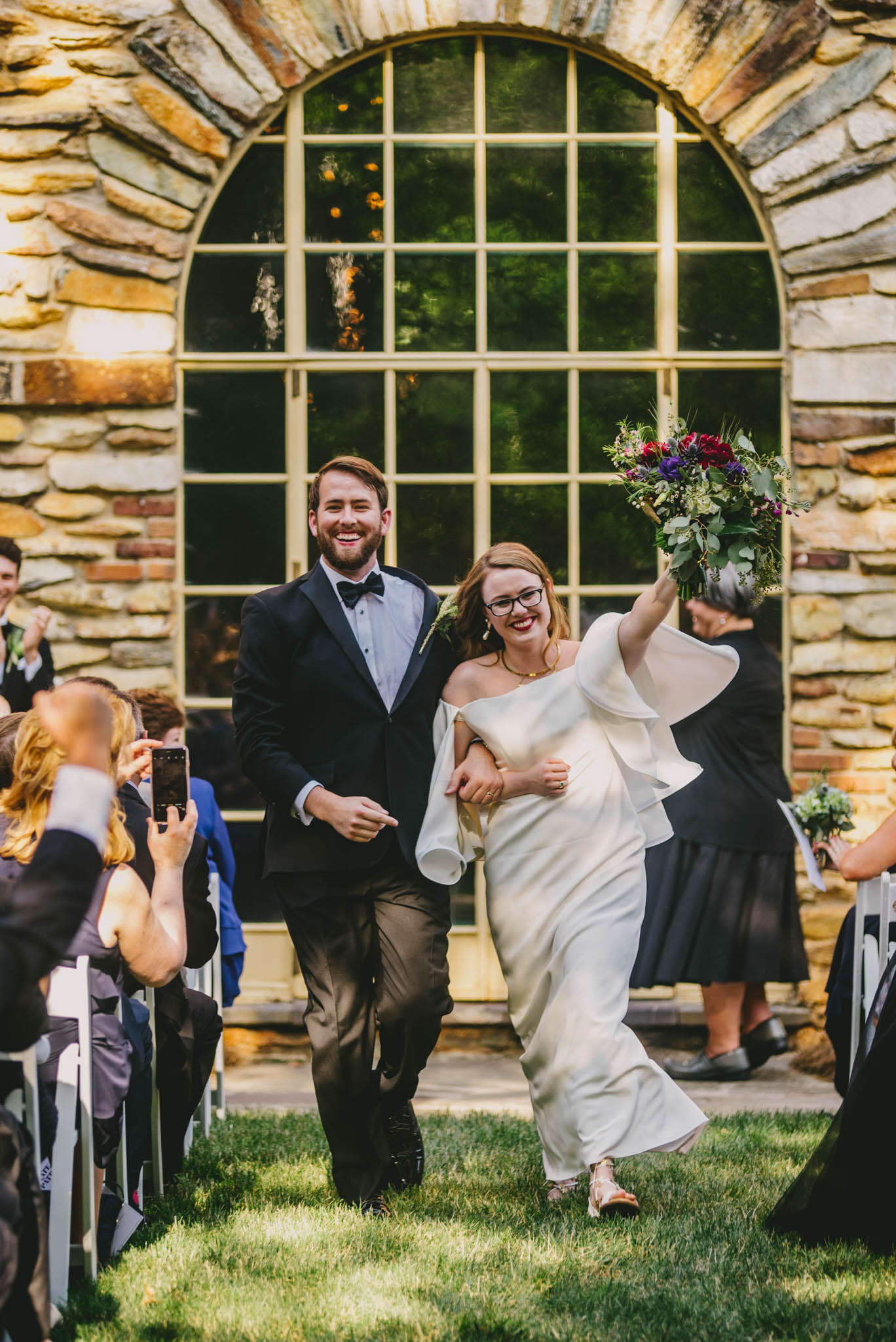 couple celebrating after their graylyn mansion wedding ceremony