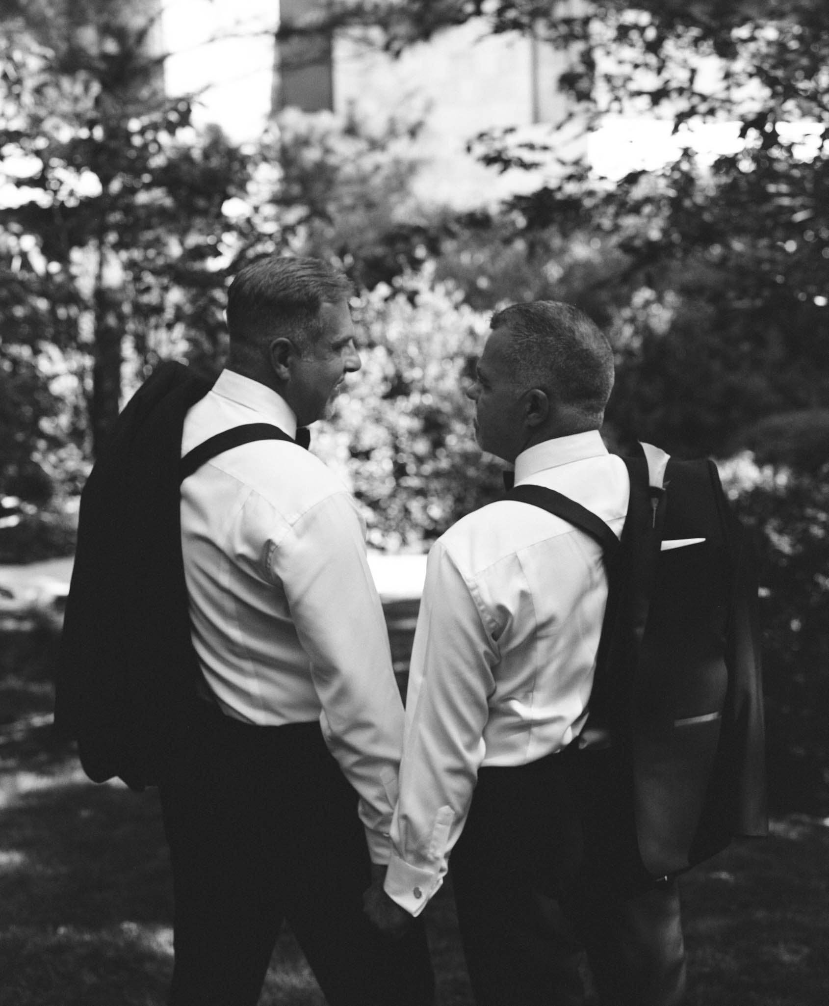 two grooms enjoying one last moment before their wedding ceremony at Umstead Hotel and Spa in Cary NC
