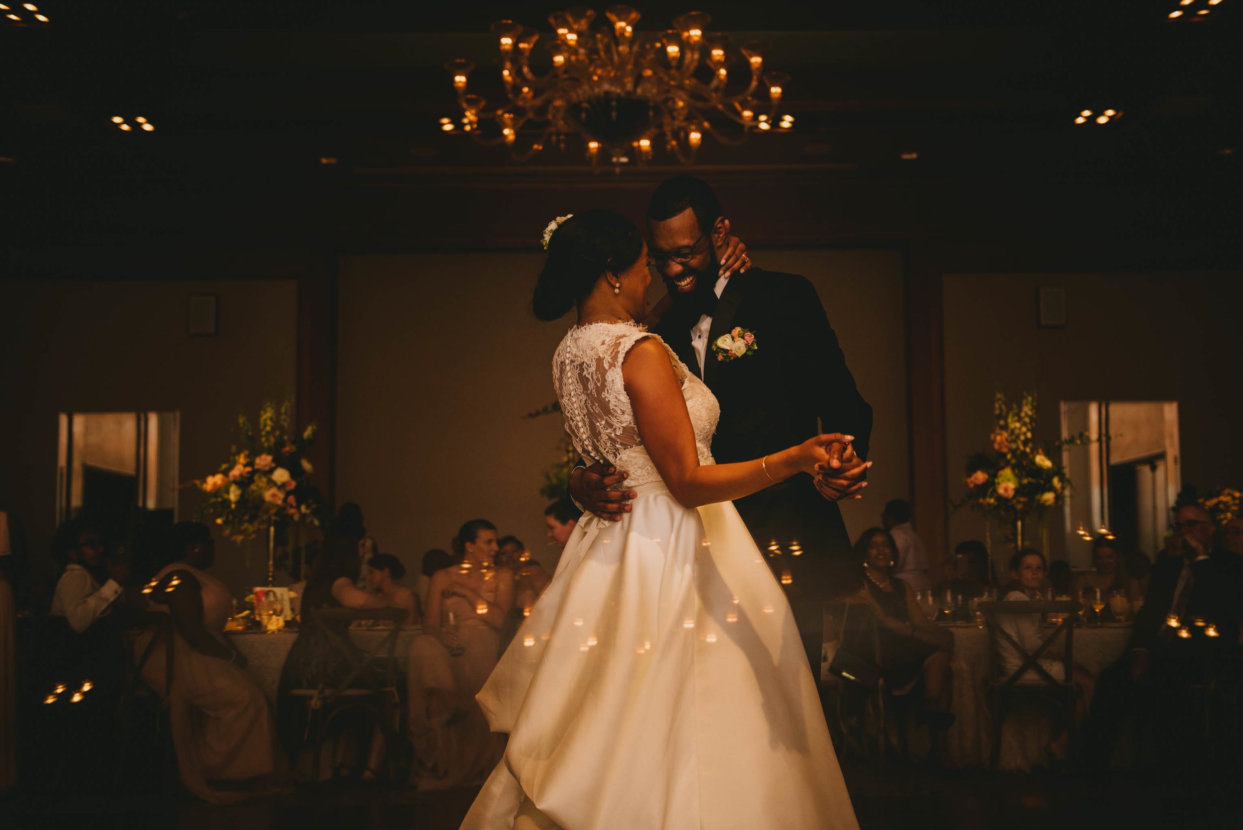 bride and groom laughing together during their first dance at the umstead hotel and spa in cary nc