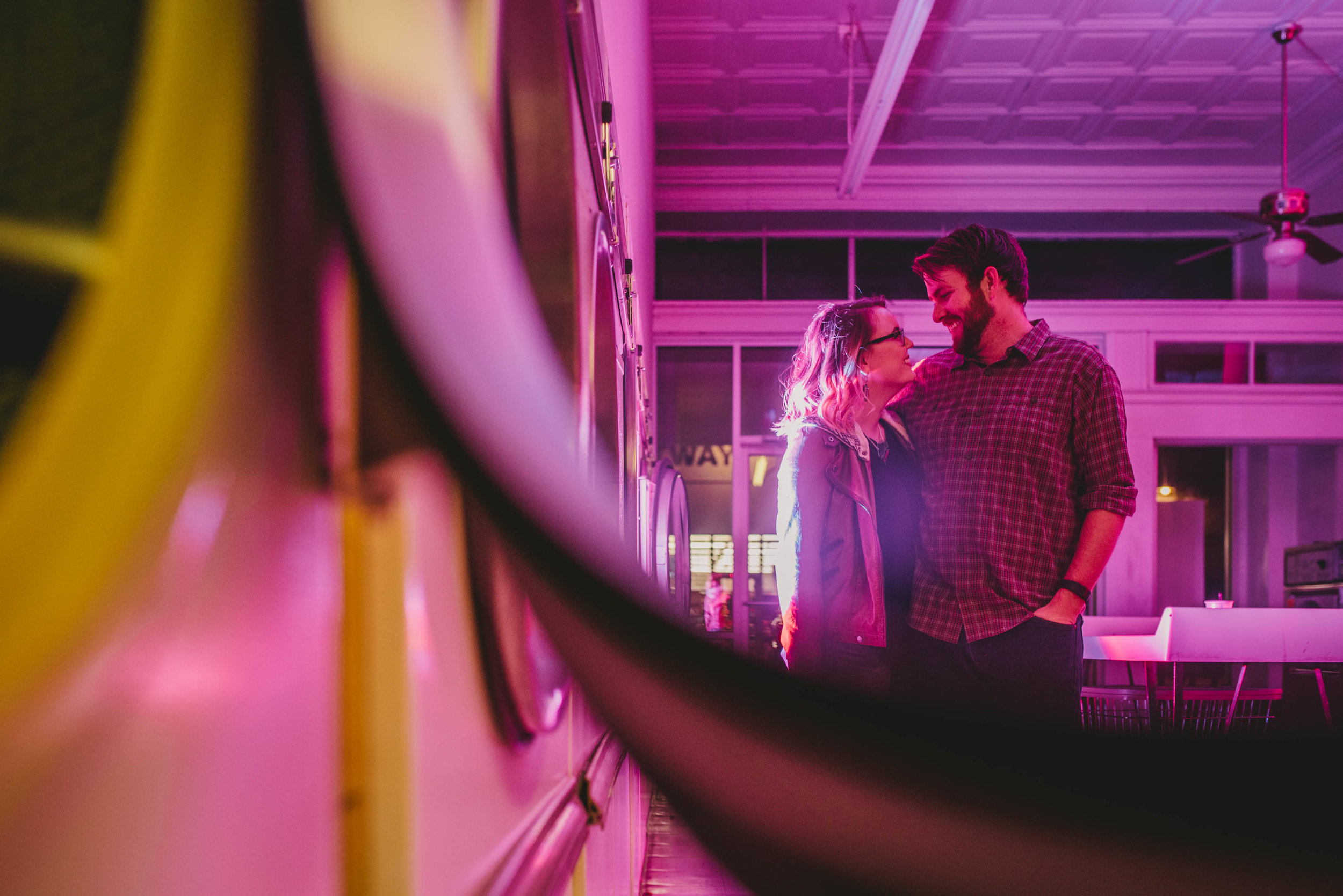 couple enjoying a few beers at suds n duds in lindley park during their engagement photos