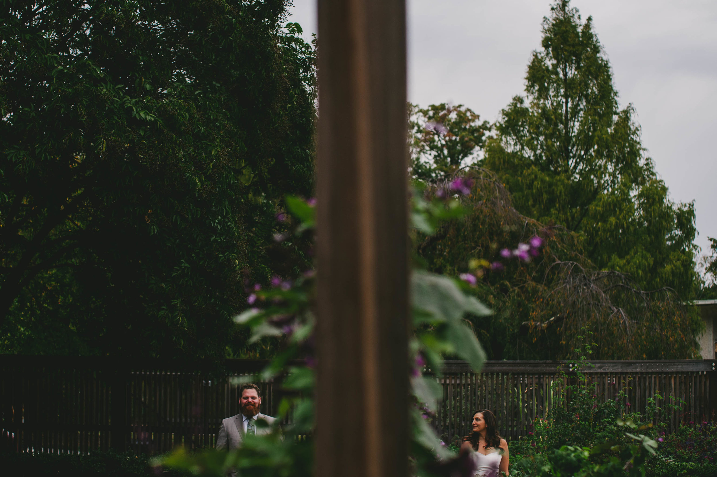 bride looking at her groom in the gardens after their national arboretum wedding in washington dc