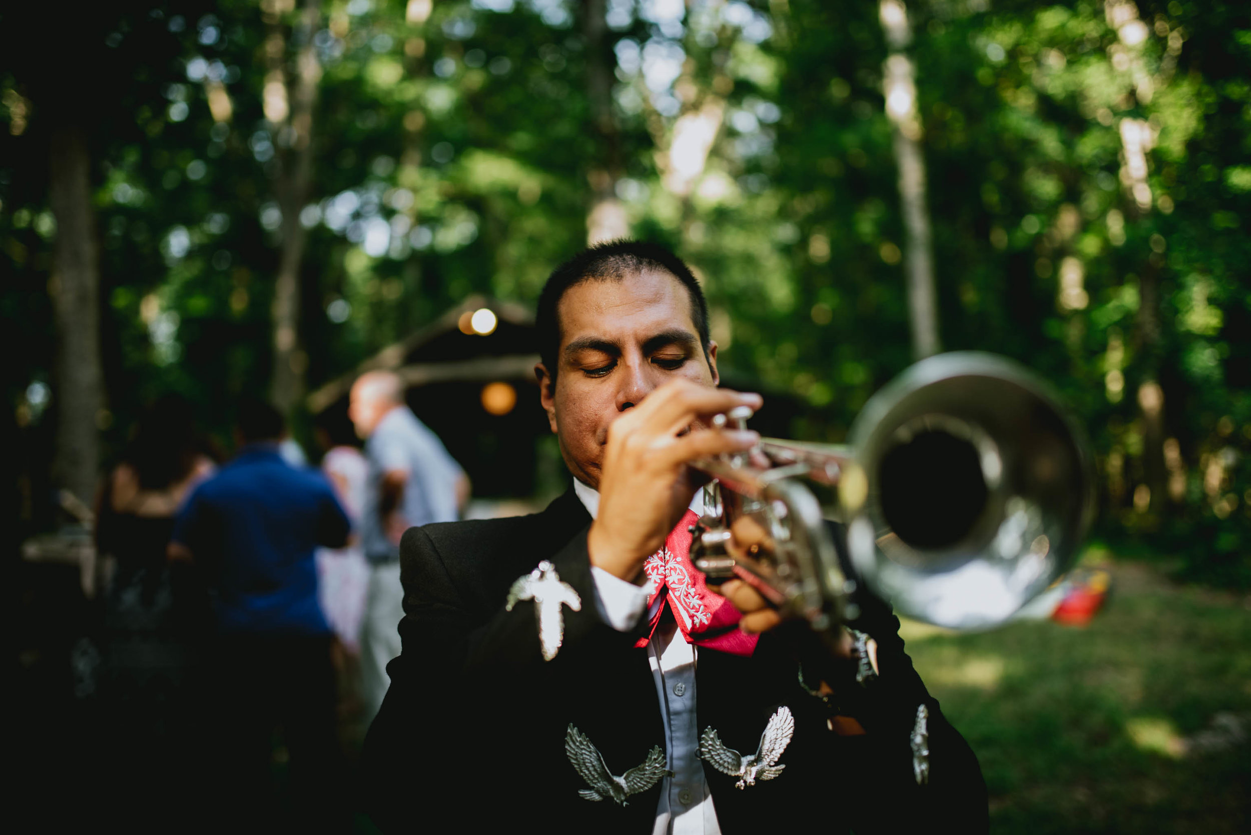 mariachi trumpeter after wedding ceremony at duke forest