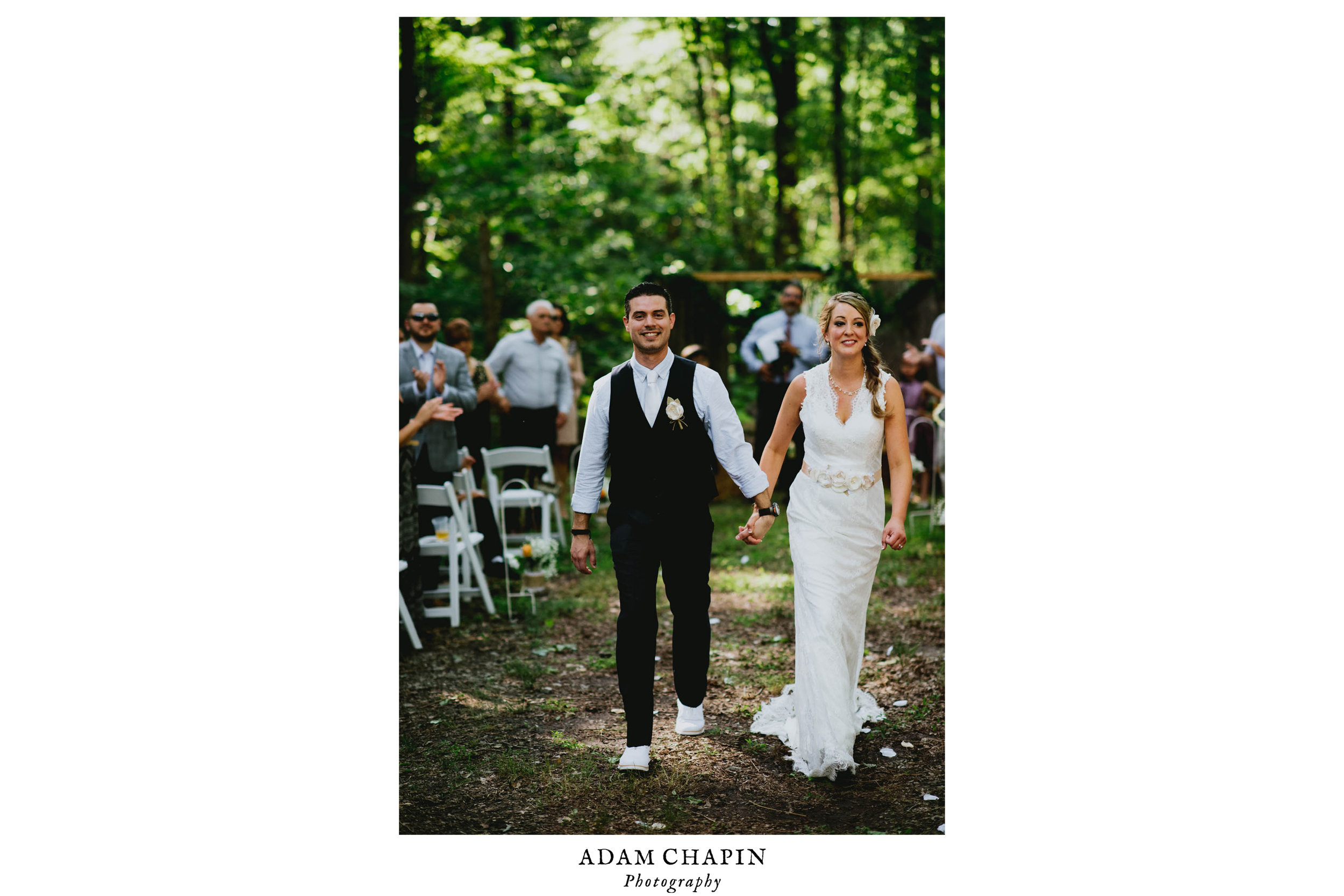 bride and groom smiling during recessional